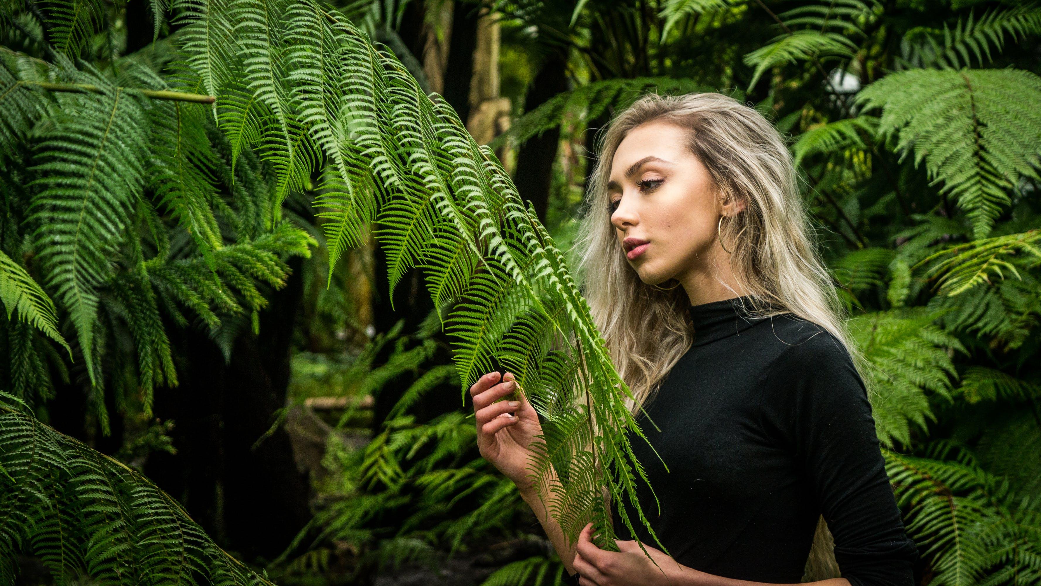 Photo of Girl Holding Fern