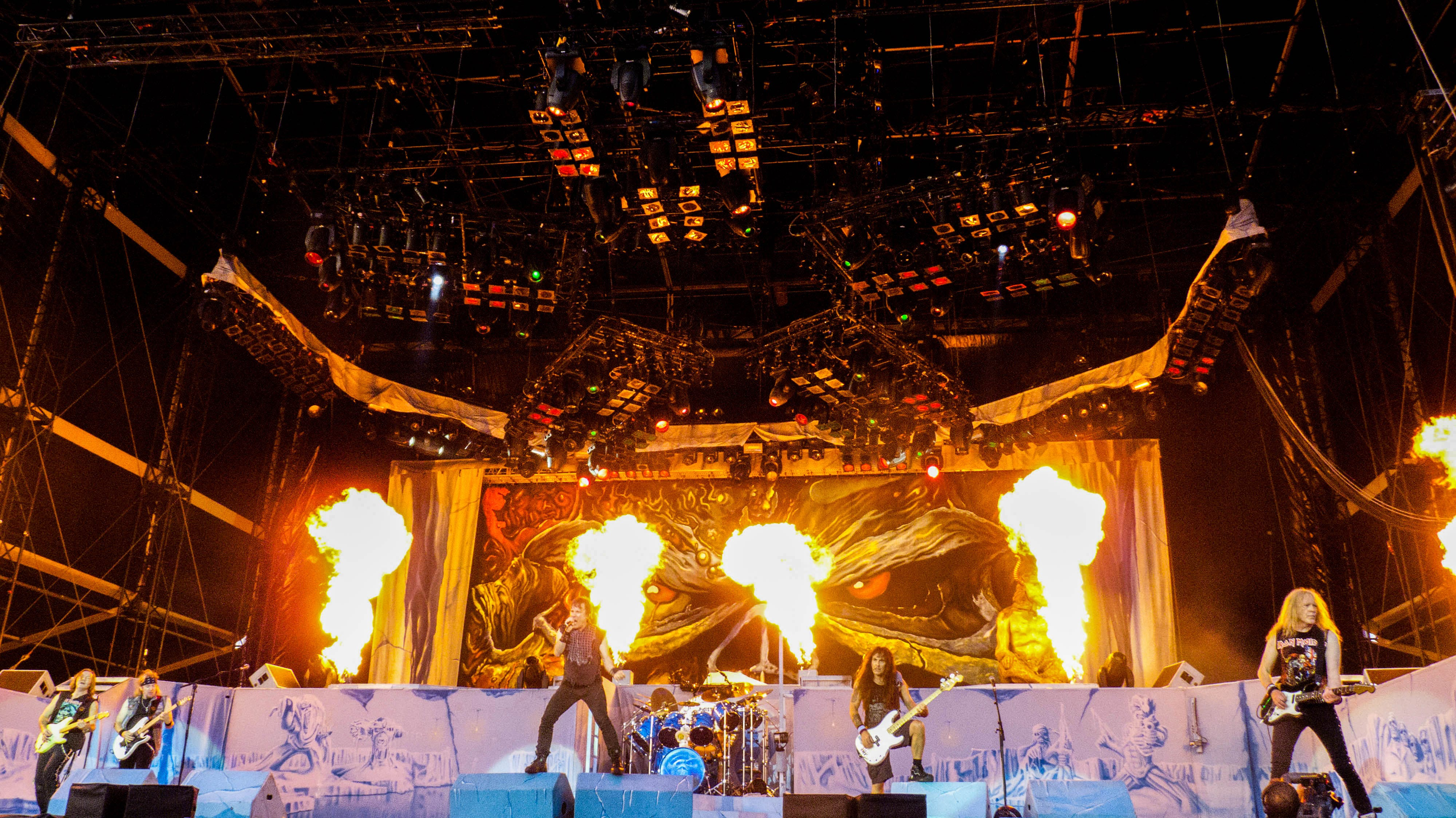 Band Playing on Stage With Fire