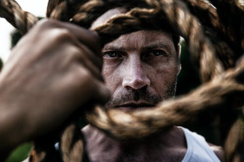 Selective Focus Photograph Of Man And Rope
