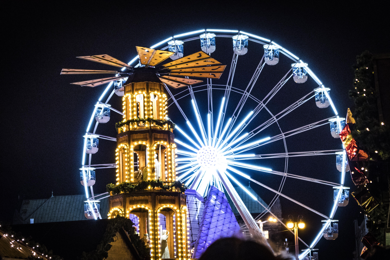 Tower Near Ferris Wheel At Night Time