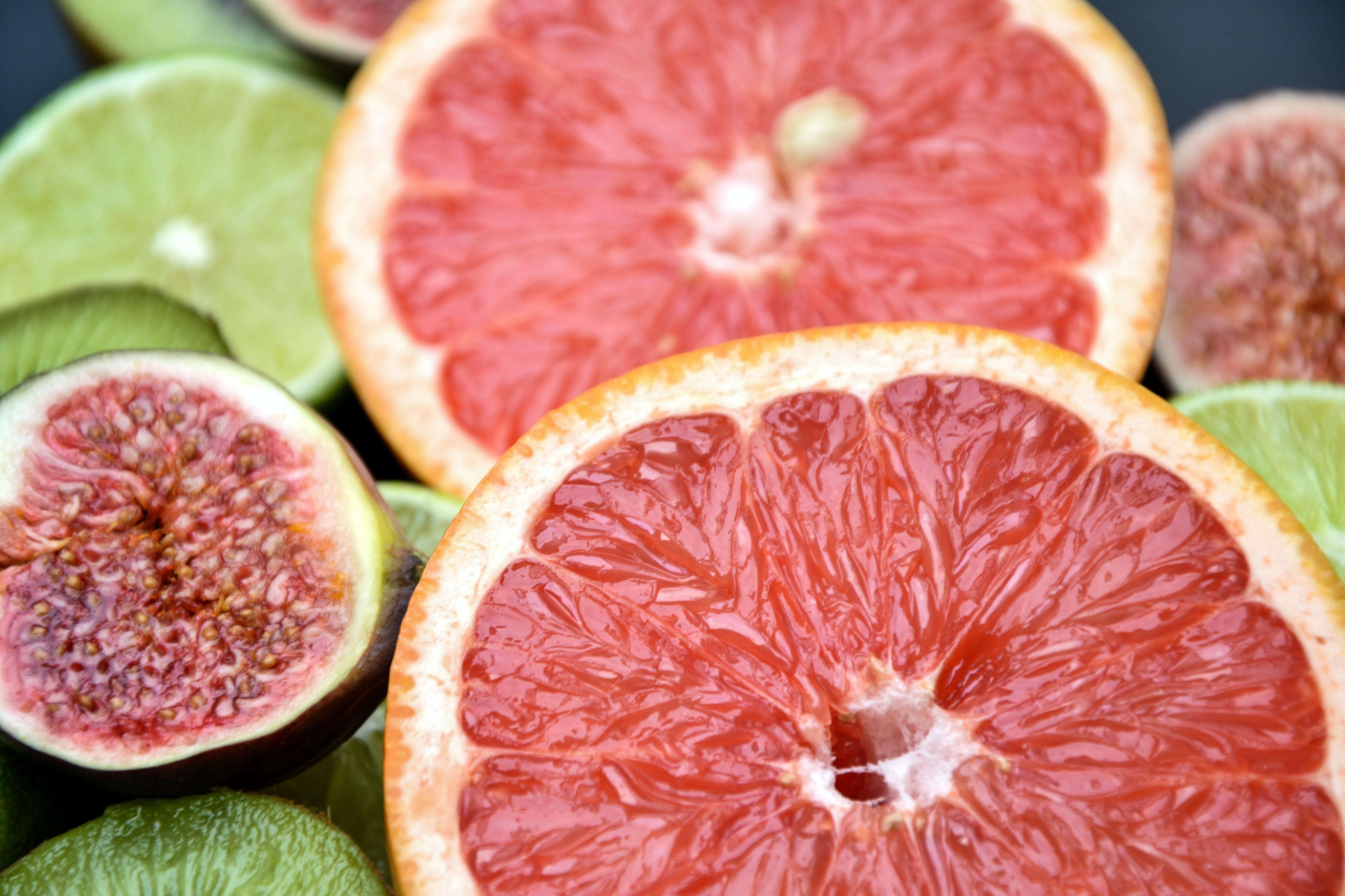 Close-up Photo of Grapefruits, Fig, and Limes