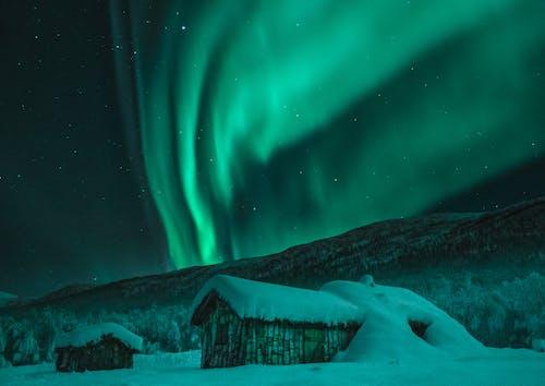 Photos gratuites de aurore boréale, aurore boréales, cabane, célébrités