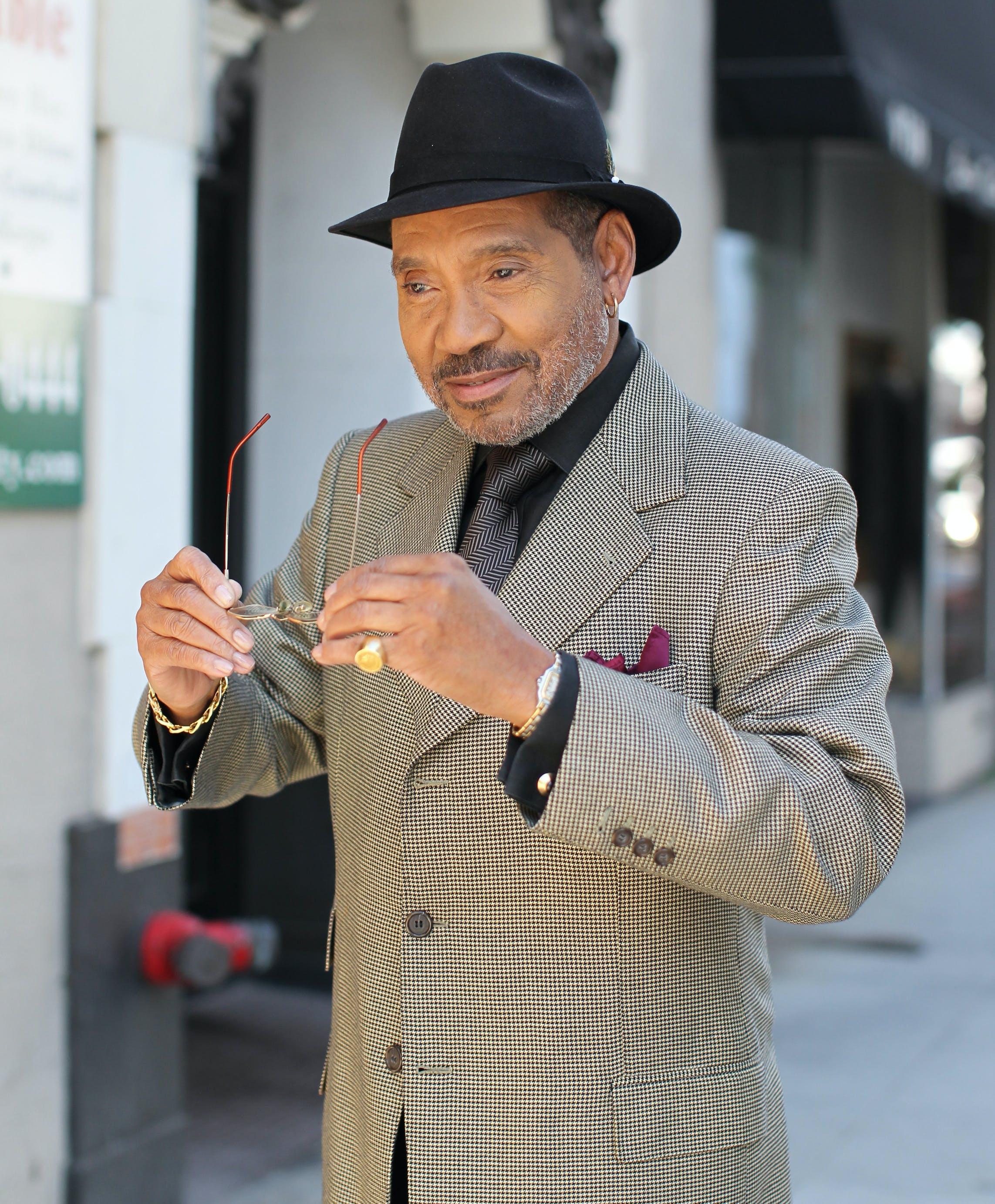 Photo of a Man Wearing Black Fedora Hat