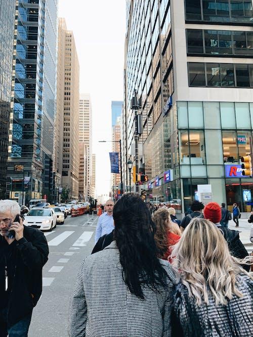People Crossing on Street Near Building