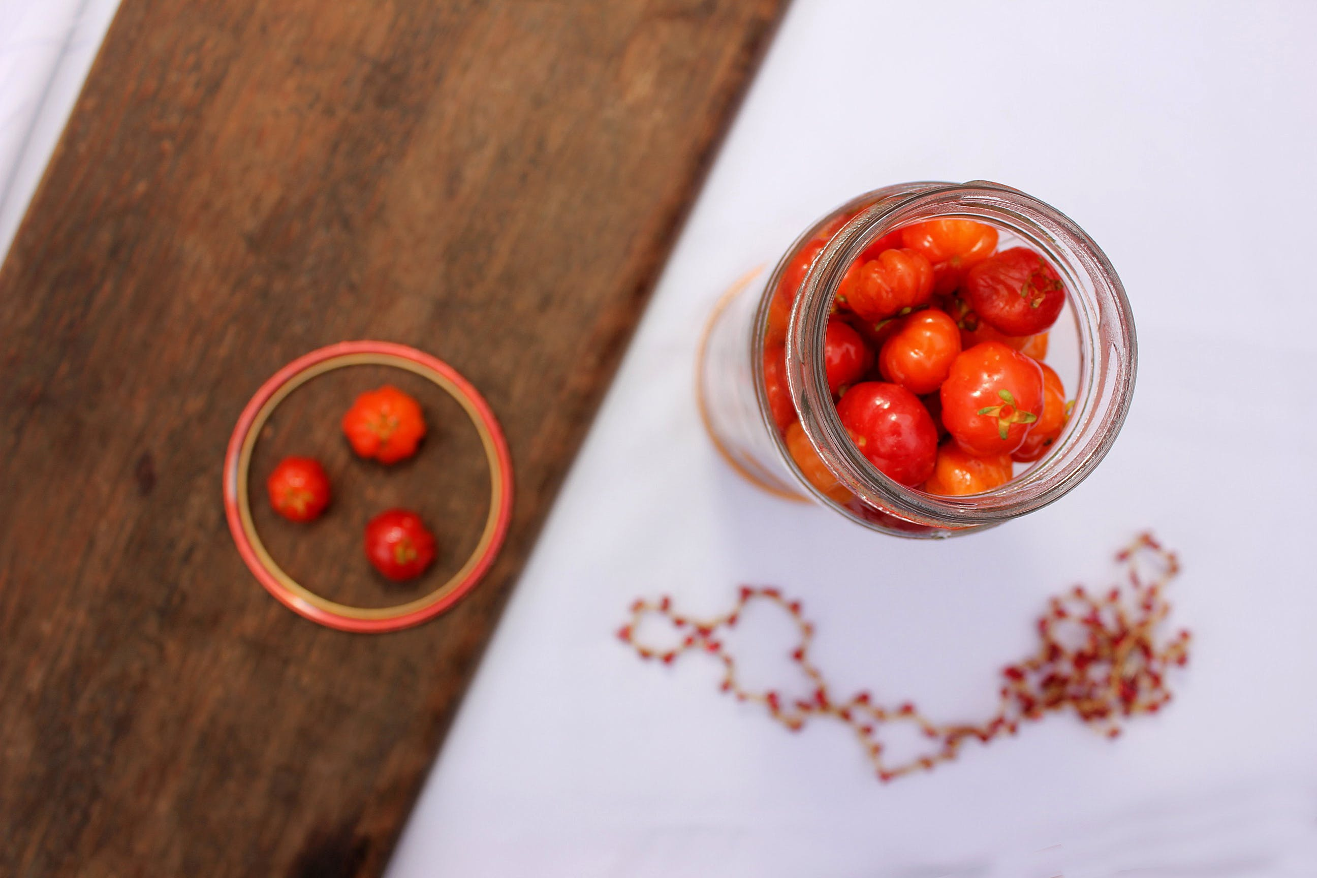 Round Red Fruit on Clear Glass Container