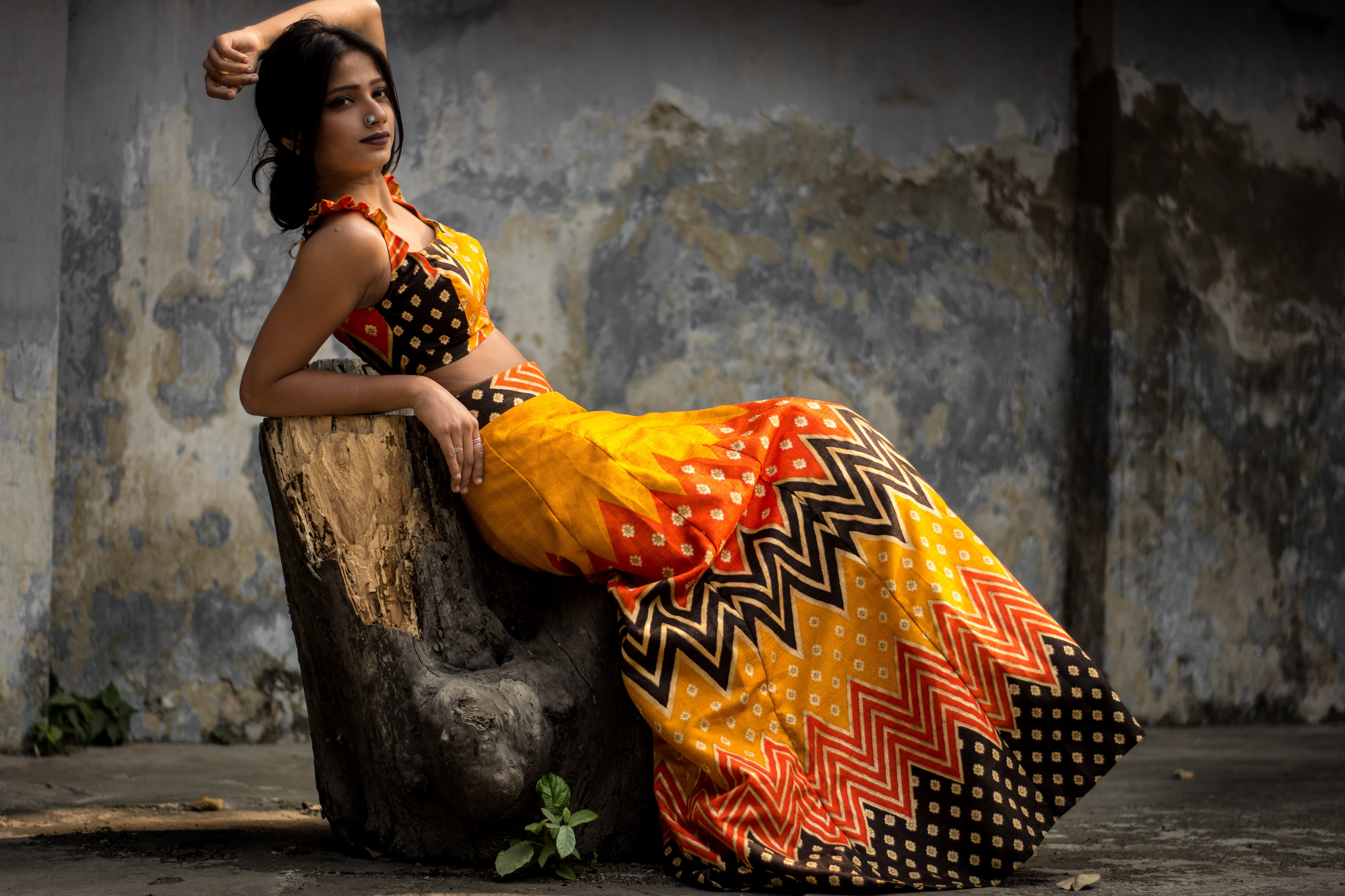 Photo of Woman Leaning on Tree Trunk