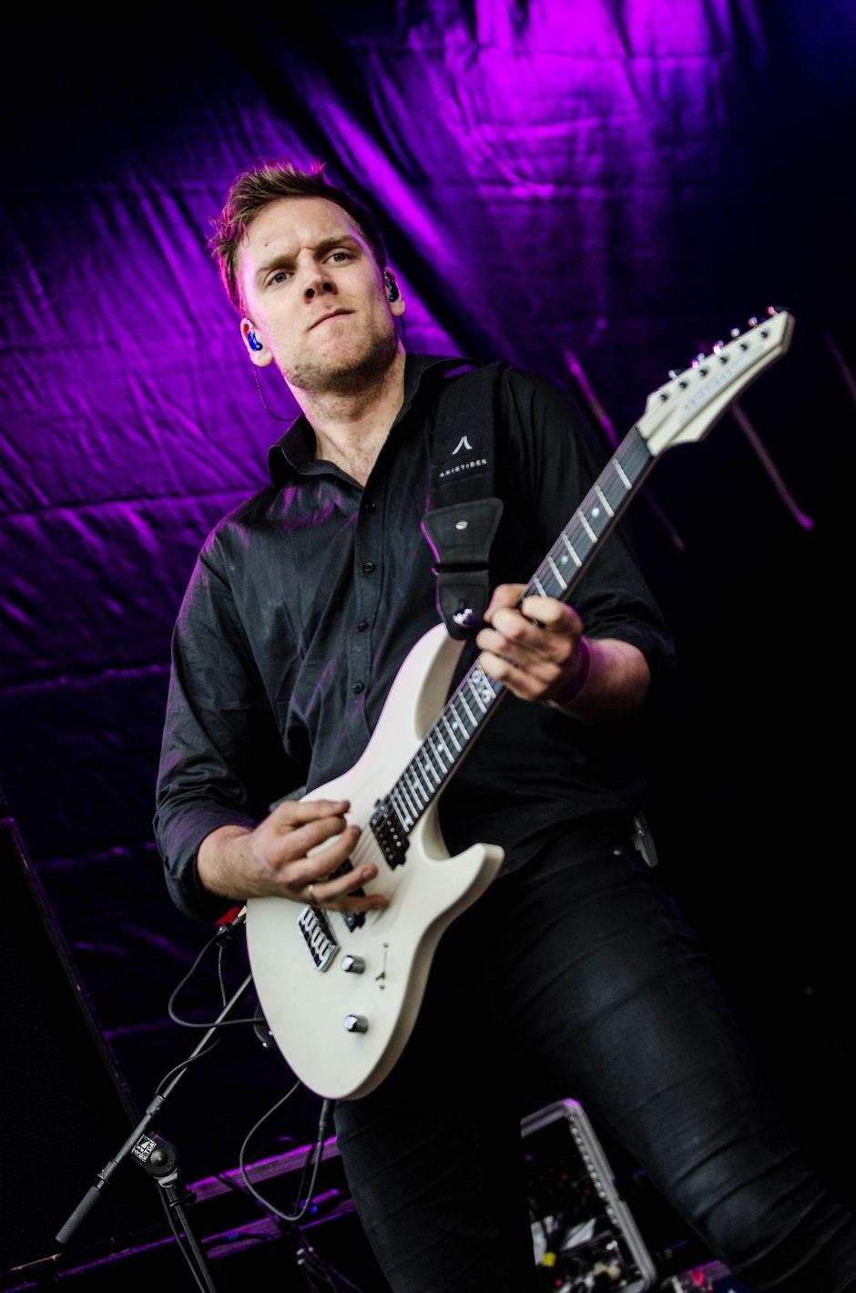 Man in Black Dress Shirt Playing Guitar