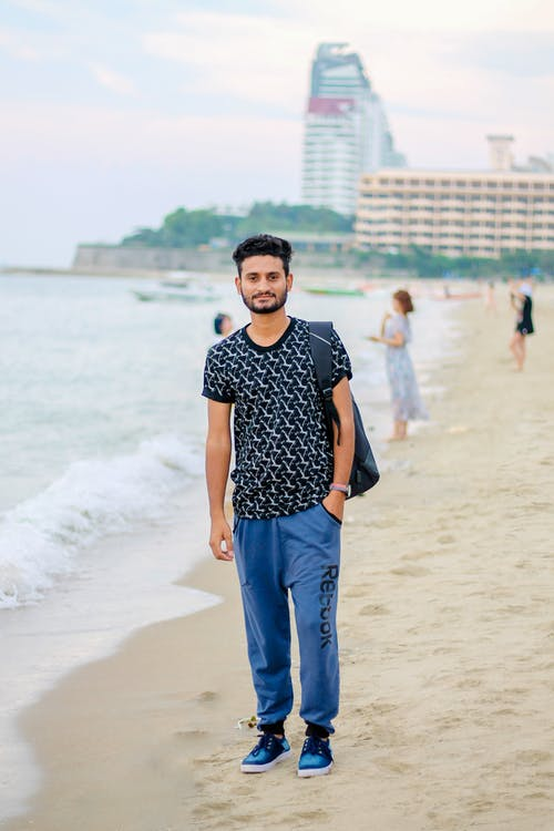 Smiling Man Standing on Beach