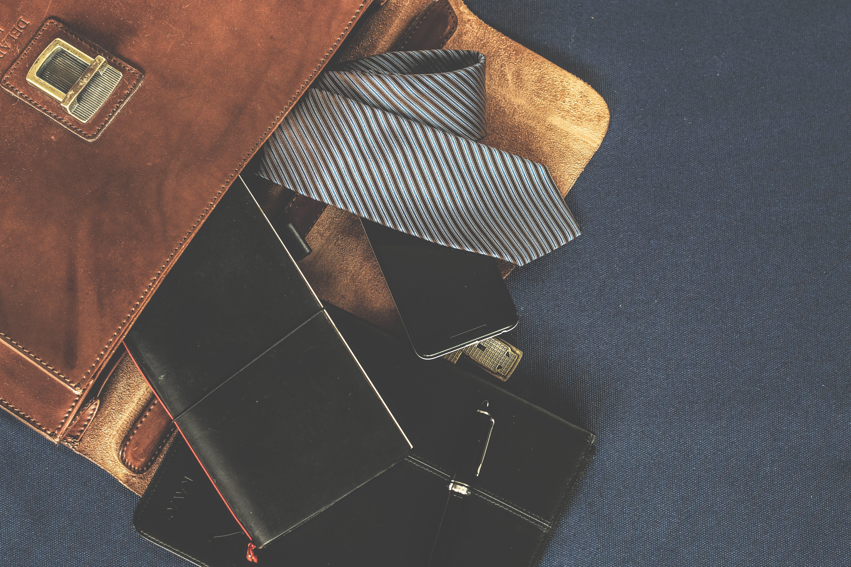 Black Leather Wallet Near the Necktie