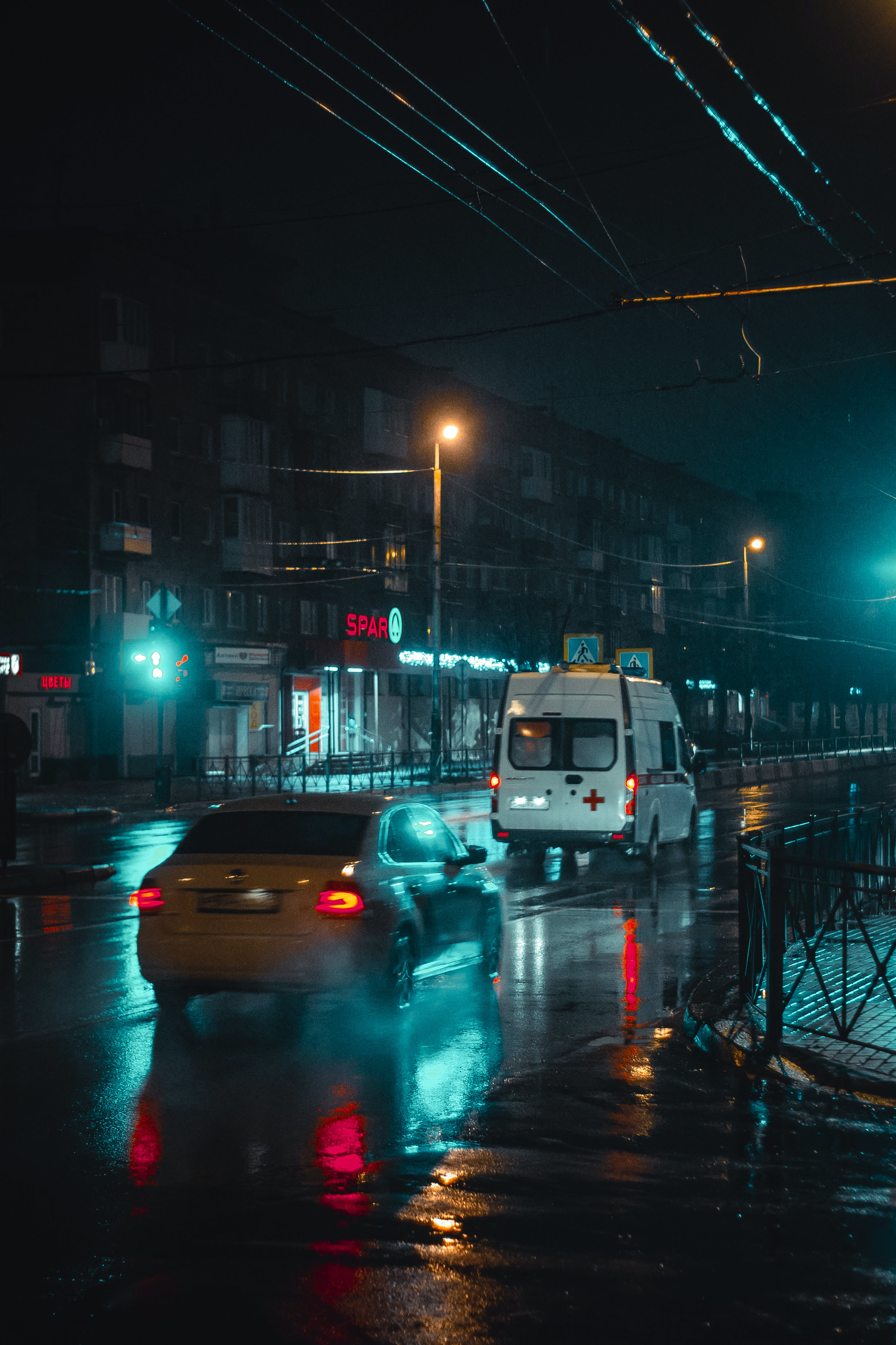 White Minivan Travelling on Road during Nighttime