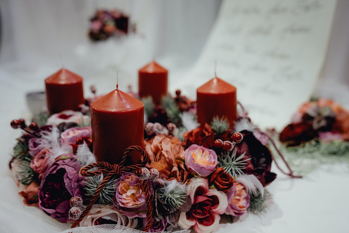 Four Red Pillar Candles on White Surface