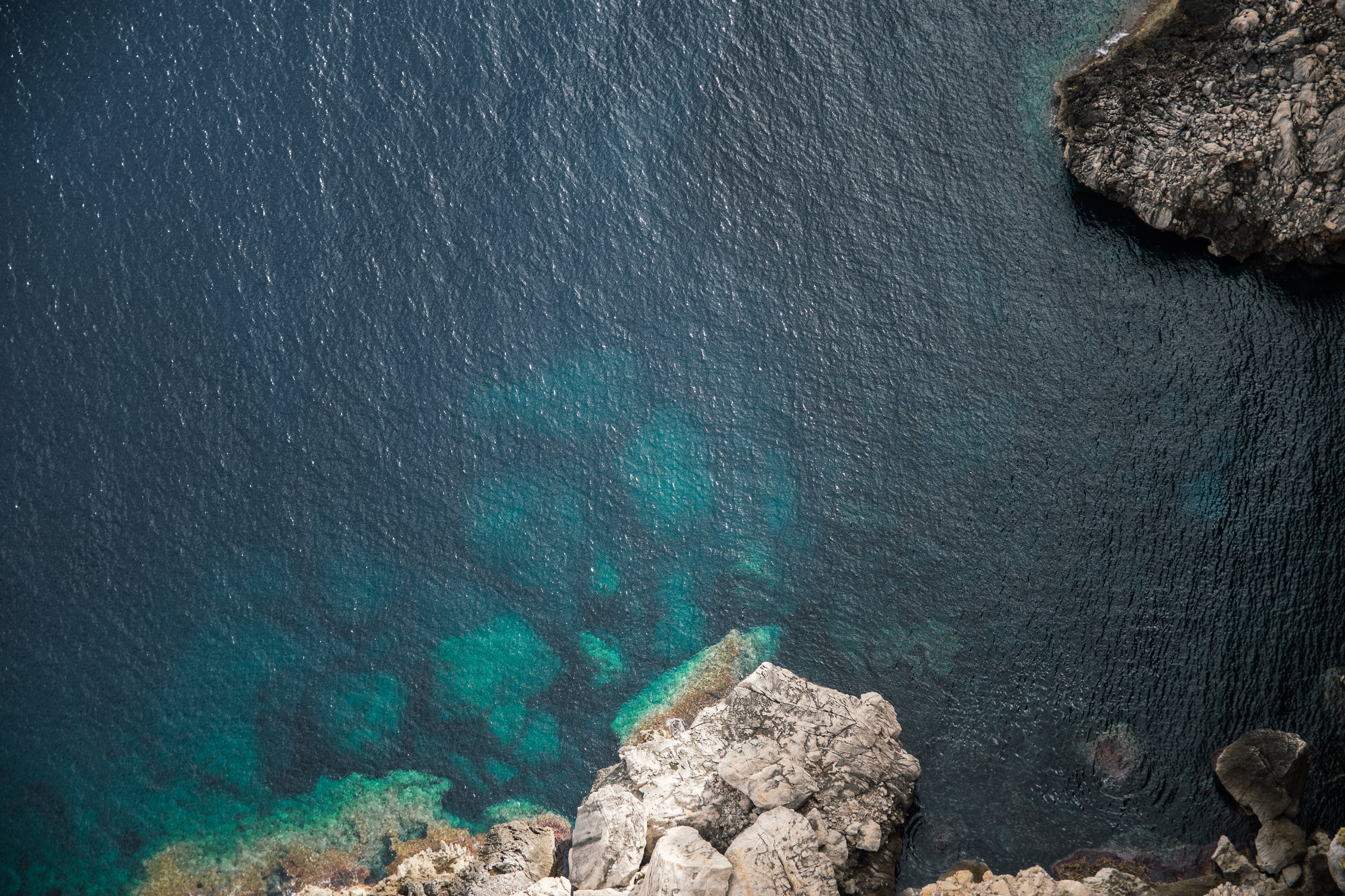 Aerial View of Rock and Water