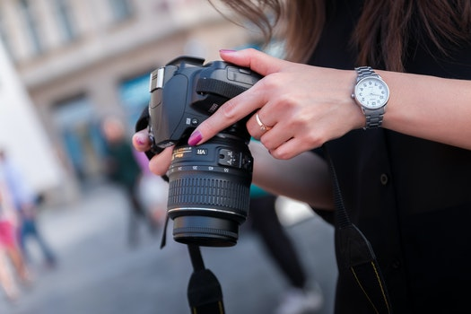 Woman Holding Black Dslr Camera