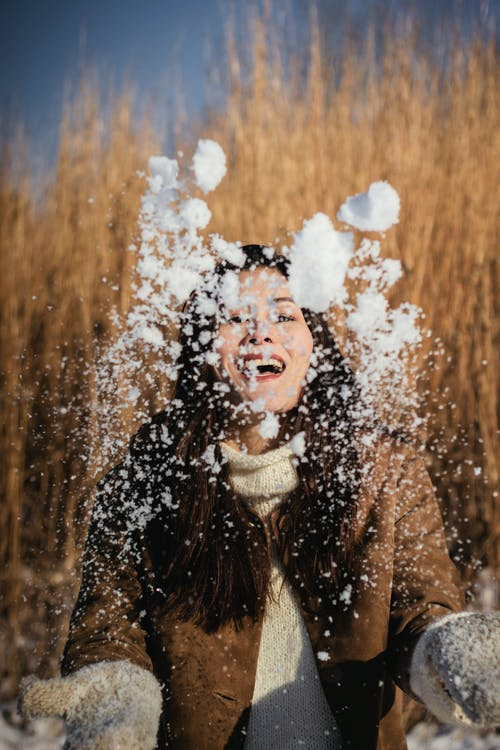 Photo of Woman Playing With Snow
