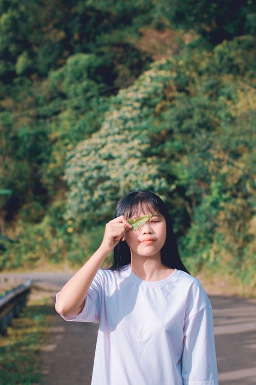 Kostenloses Stock Foto zu asiatische frau, augen geschlossen, fotoshooting, frau
