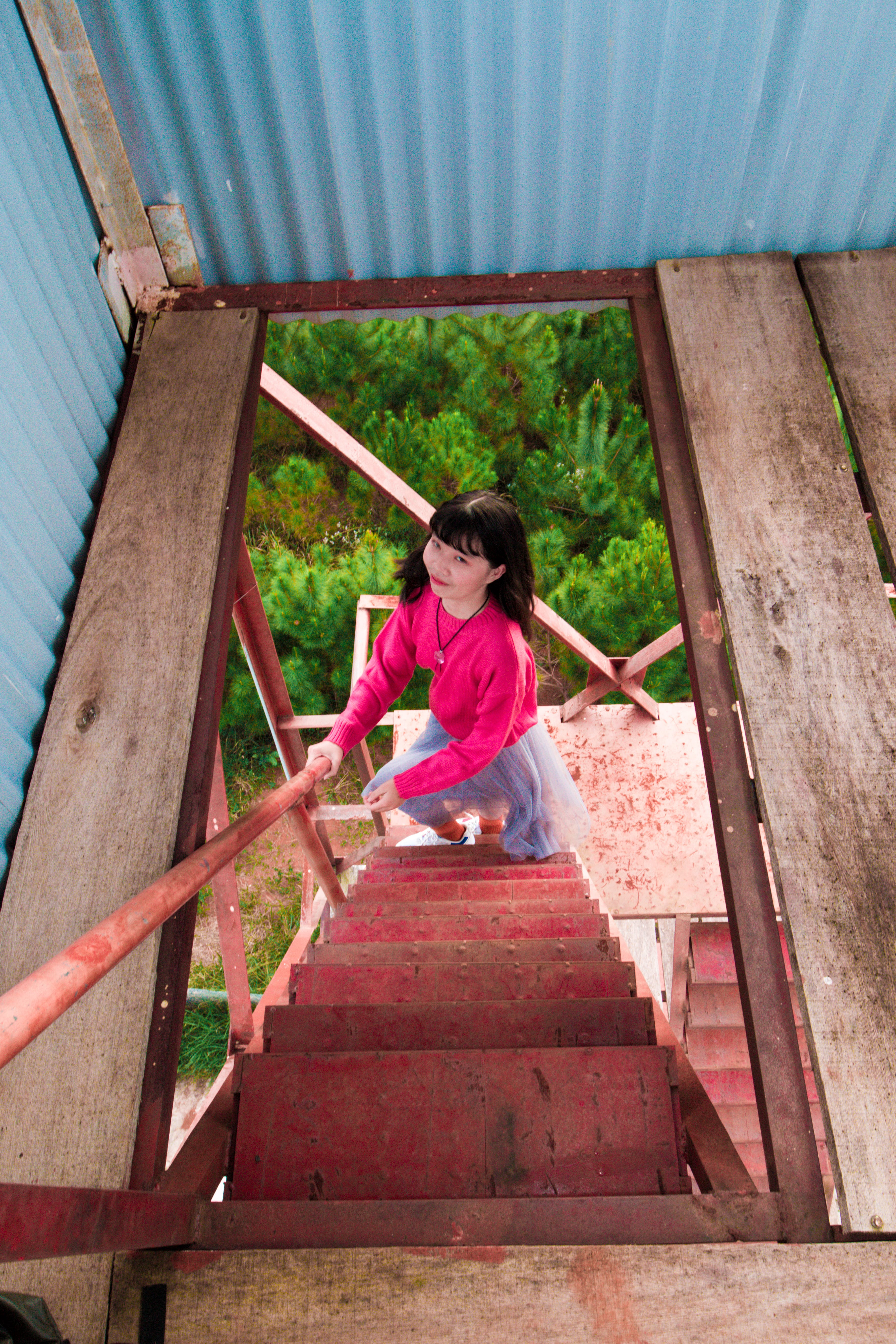 Woman Climbing On Stairs