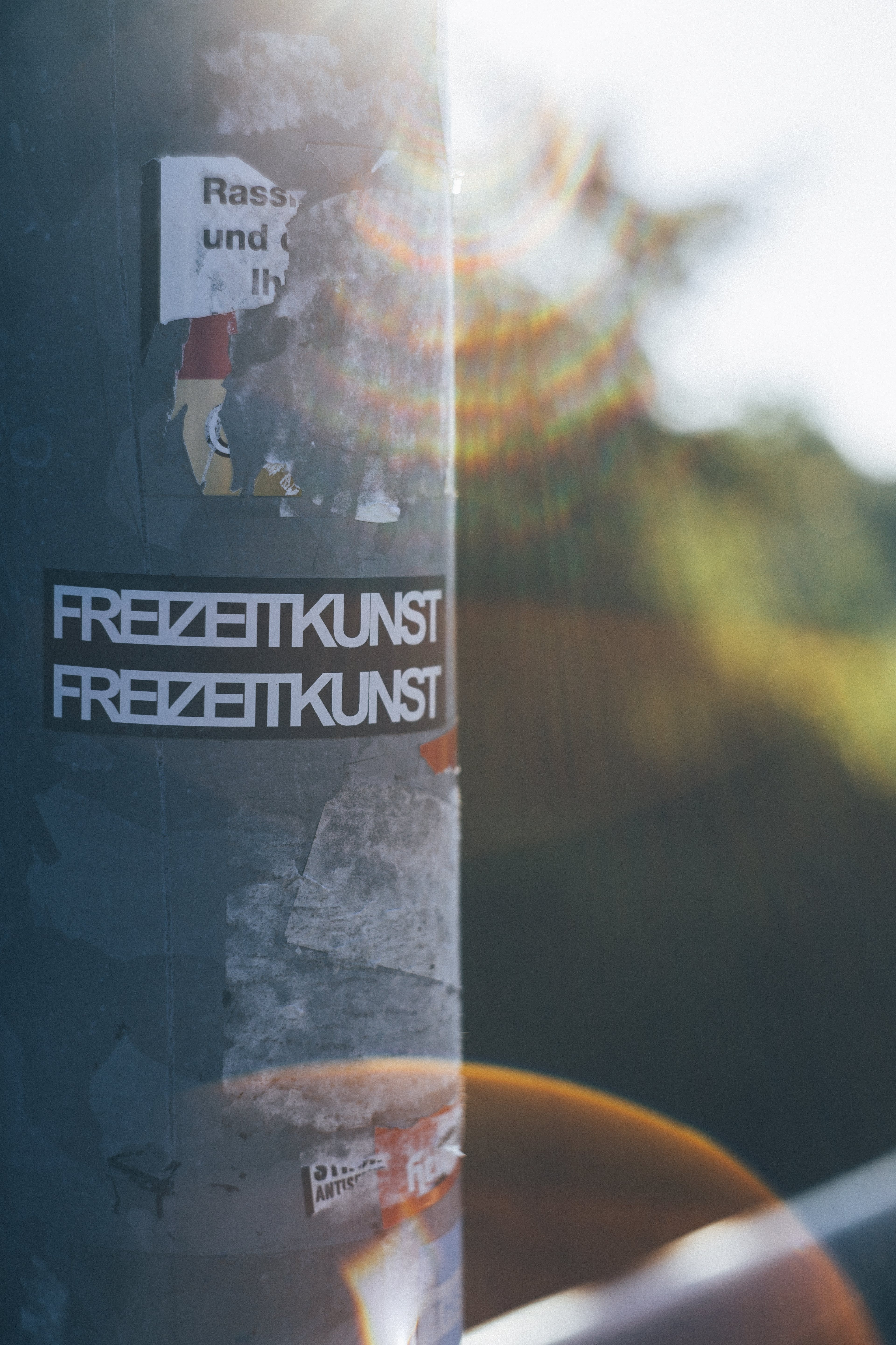 Close-Up Photo of Pole With Stickers