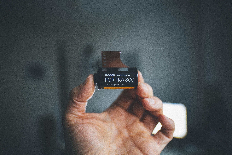 Person Holding Kodak Portra 800 Film Cartridge