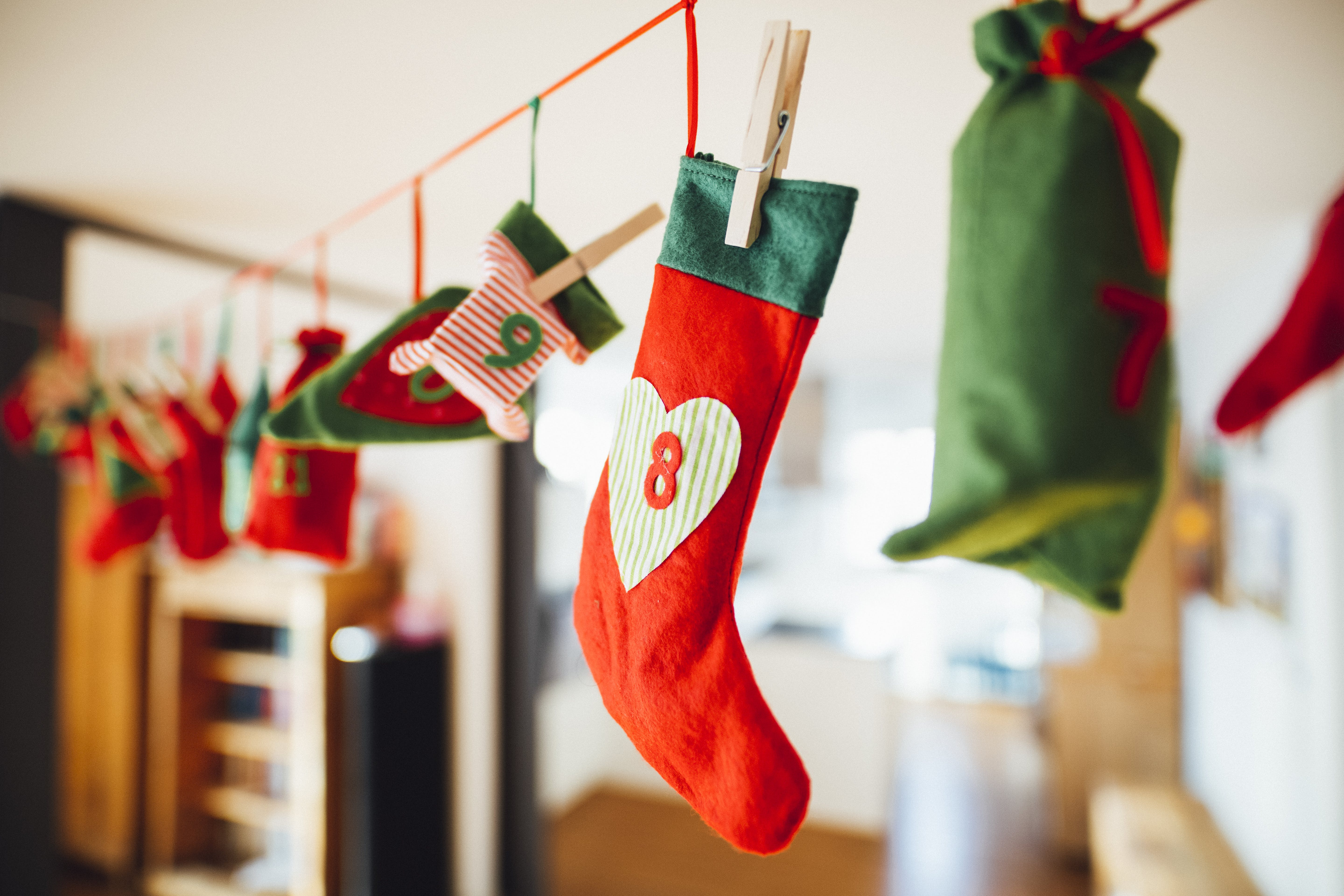 Red and Green Christmas Stocking Hanging Inside Room