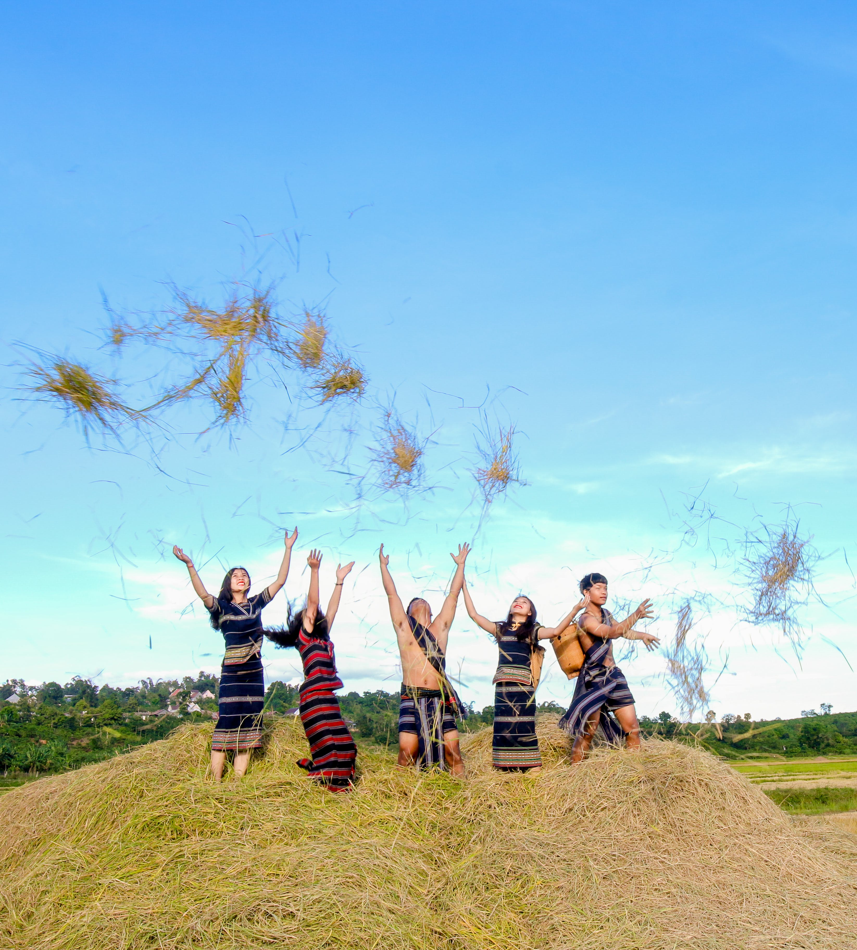 Four People Standing on Hay While Throwing Up
