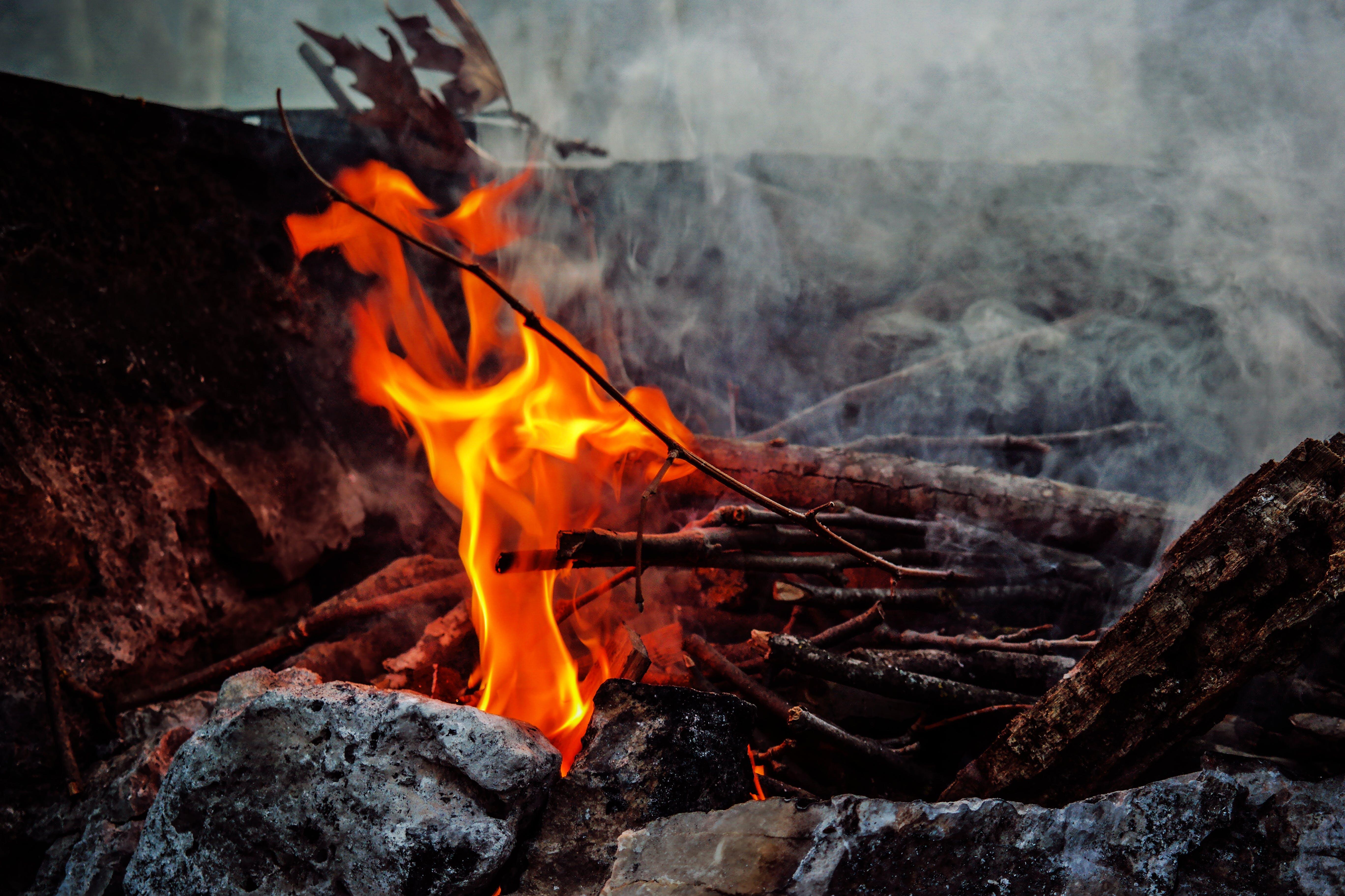 Burning Sticks Beside Rocks