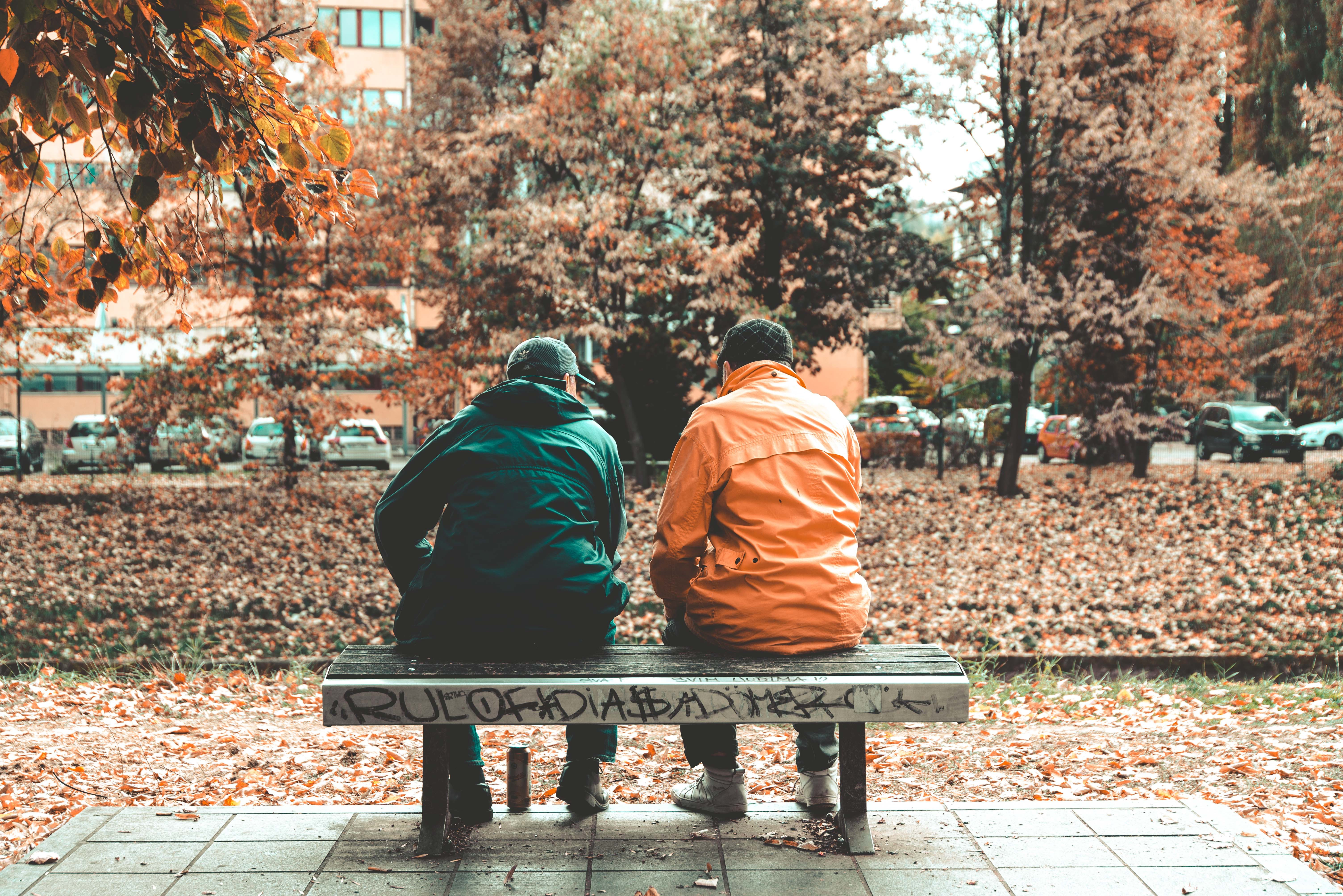 Two Men Sitting on Bench