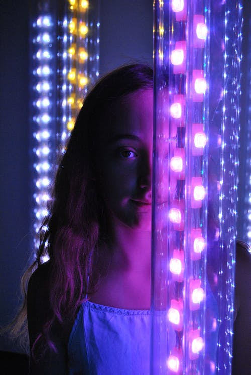 Girl Standing In the Middle Of Neon Lights