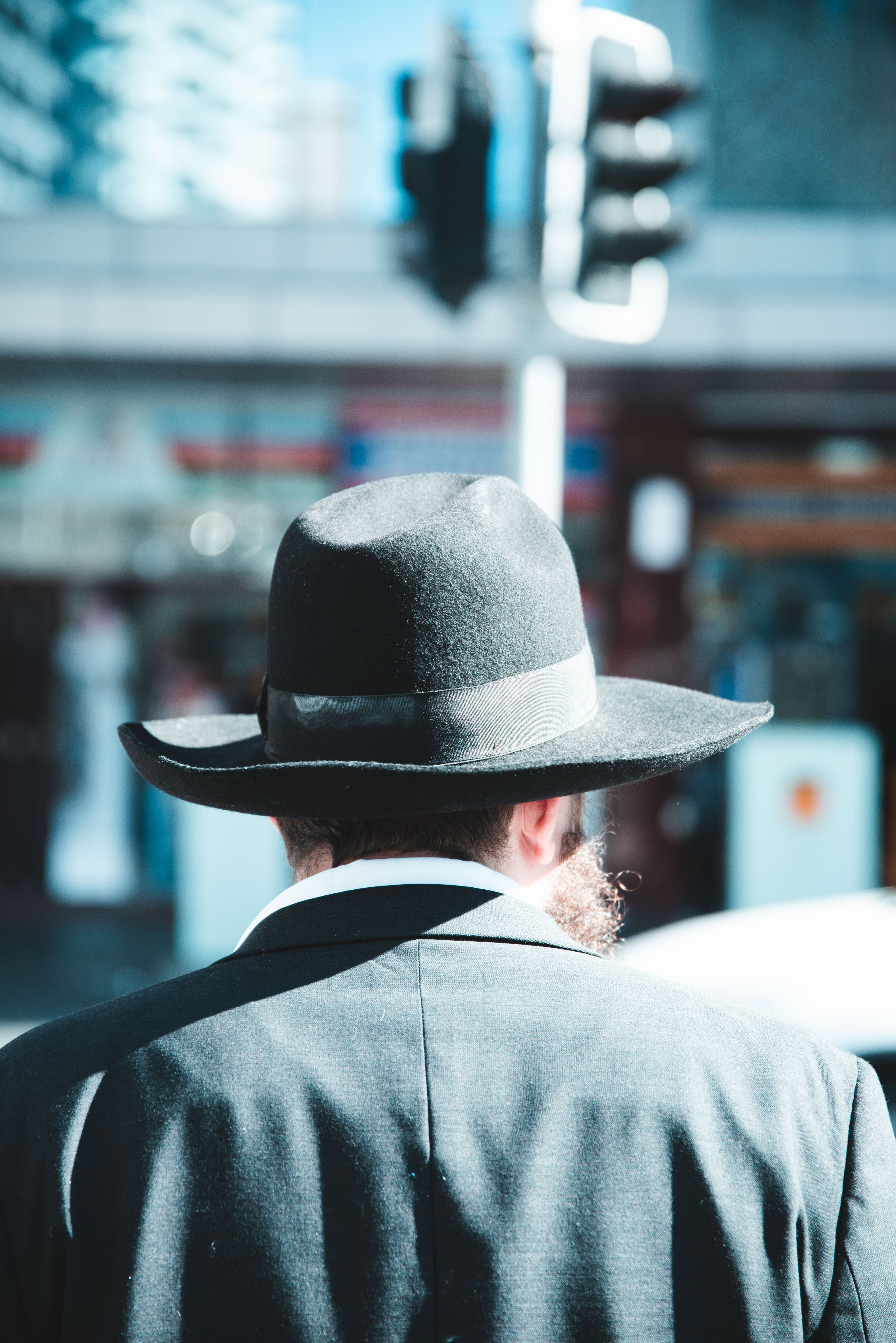 Selective Focus Photography Of Man Wearing Fedora Hat