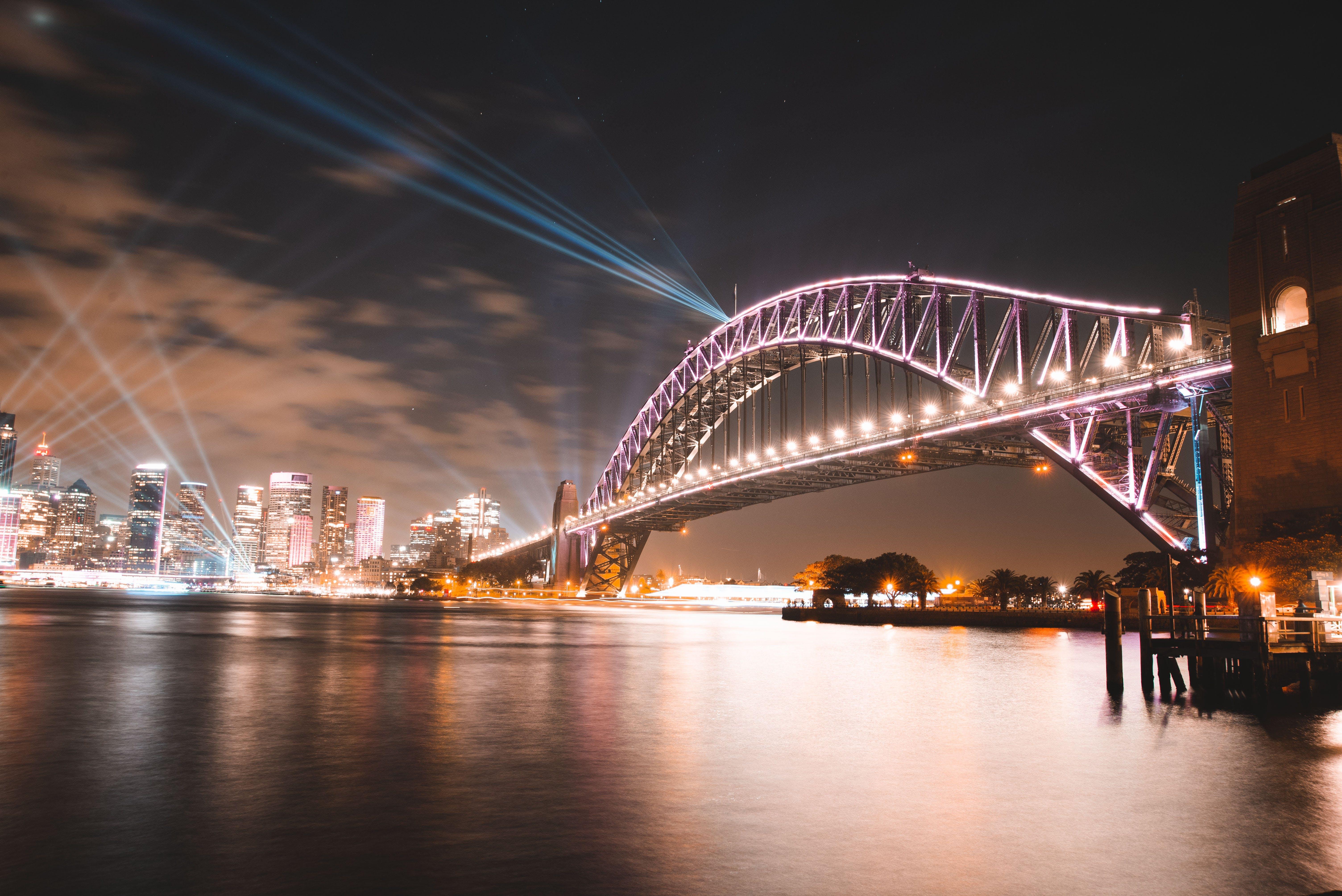 Purple Concrete Bridge Across Body of Water