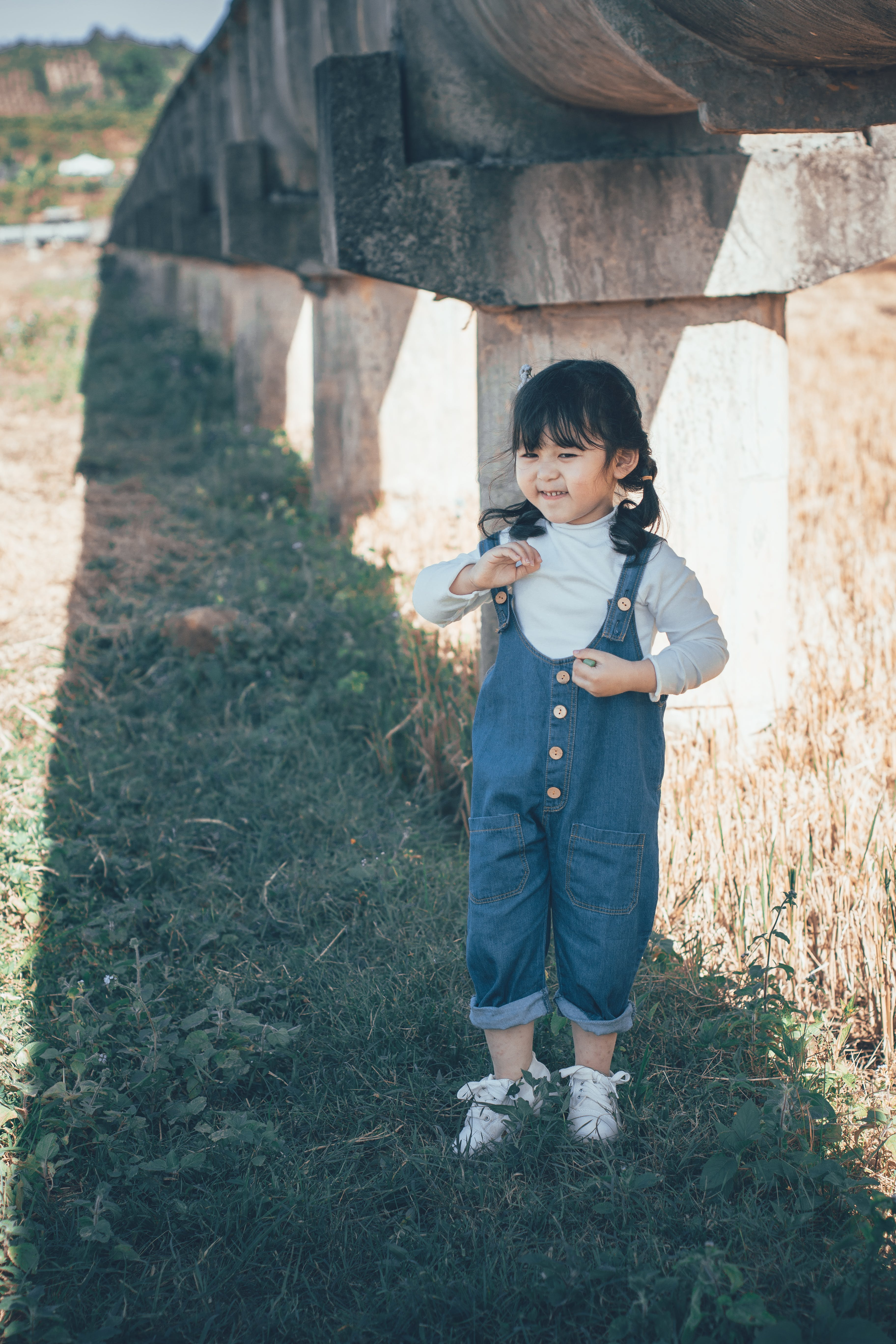 Girl Standing Under Concrete Structure