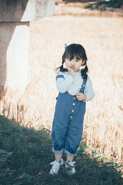 Girl Wearing Blue Denim Overalls