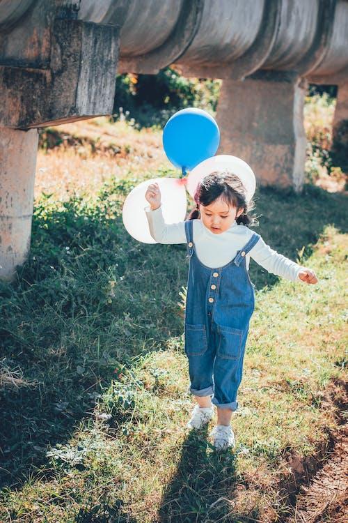 Ilmainen kuvapankkikuva tunnisteilla aasialainen lapsi, henkilö, ilmapallot, kaunis