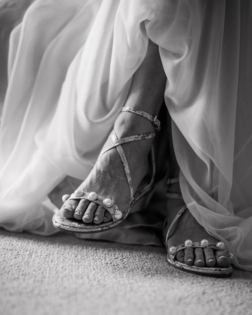 Grayscale Photography Of Woman Wearing Ankle Strap Flat Sandals