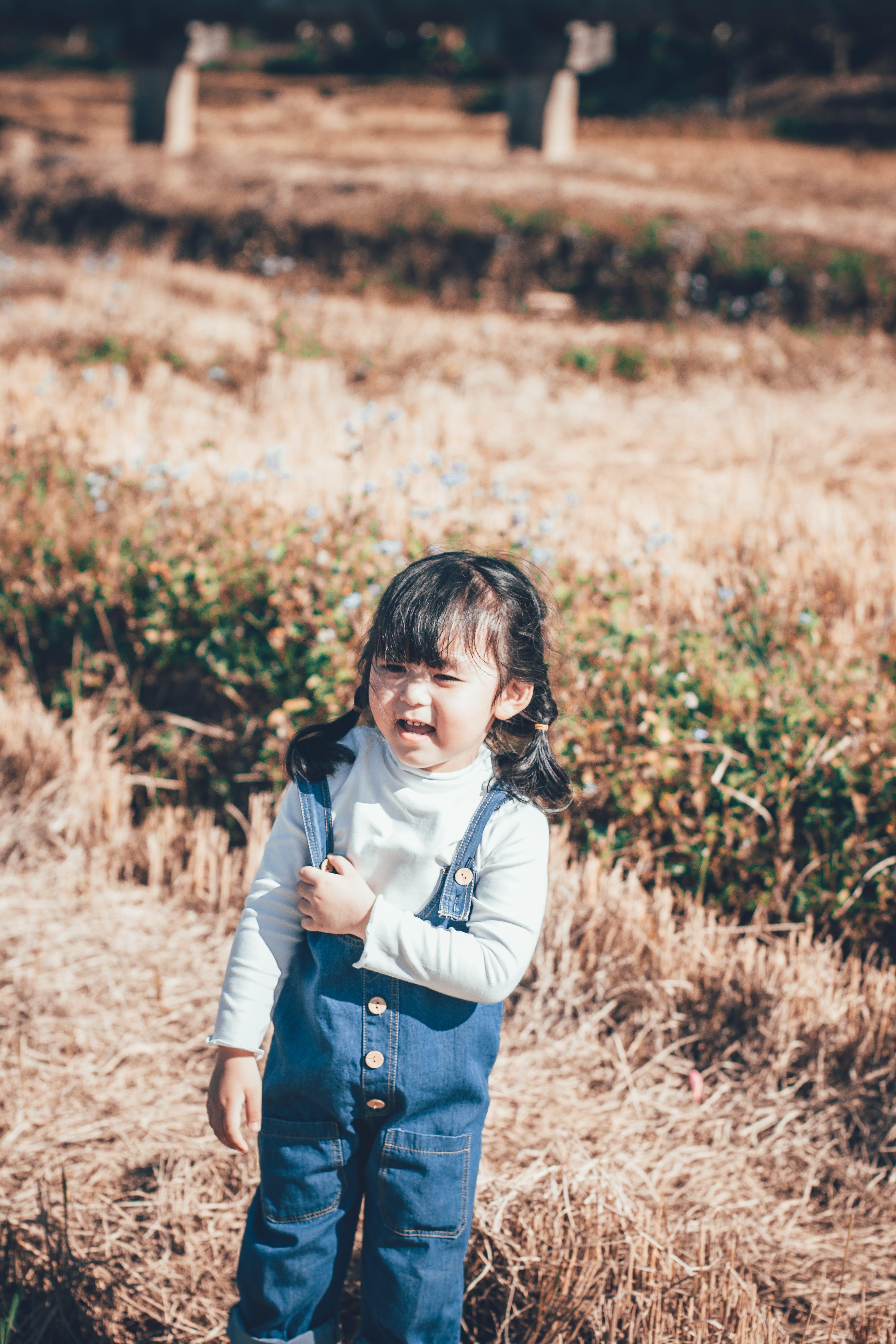 Girl Standing on Grass Field