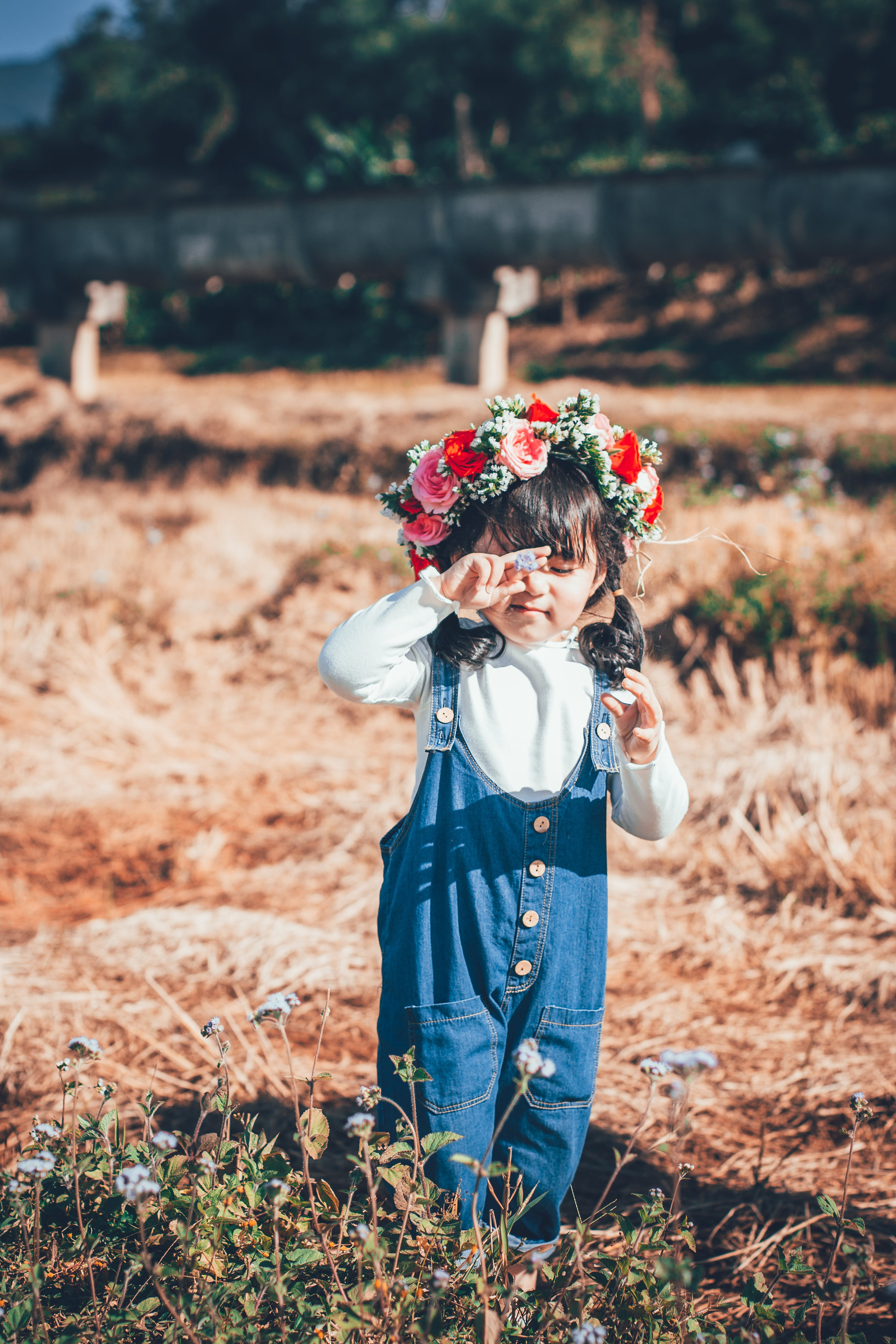 Girl Standing on Ground With Floral Headdress