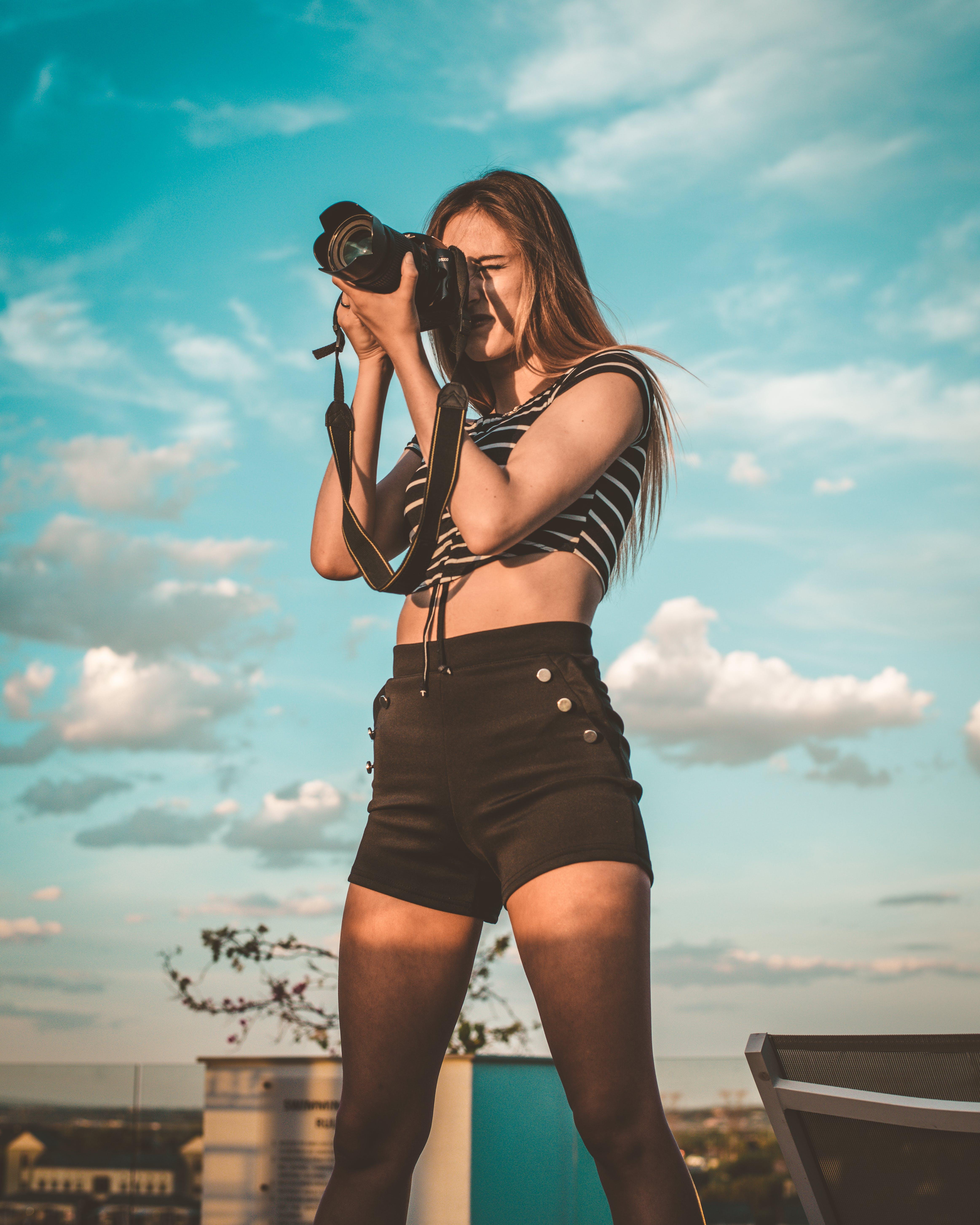 Photo of Woman Holding Dslr Camera