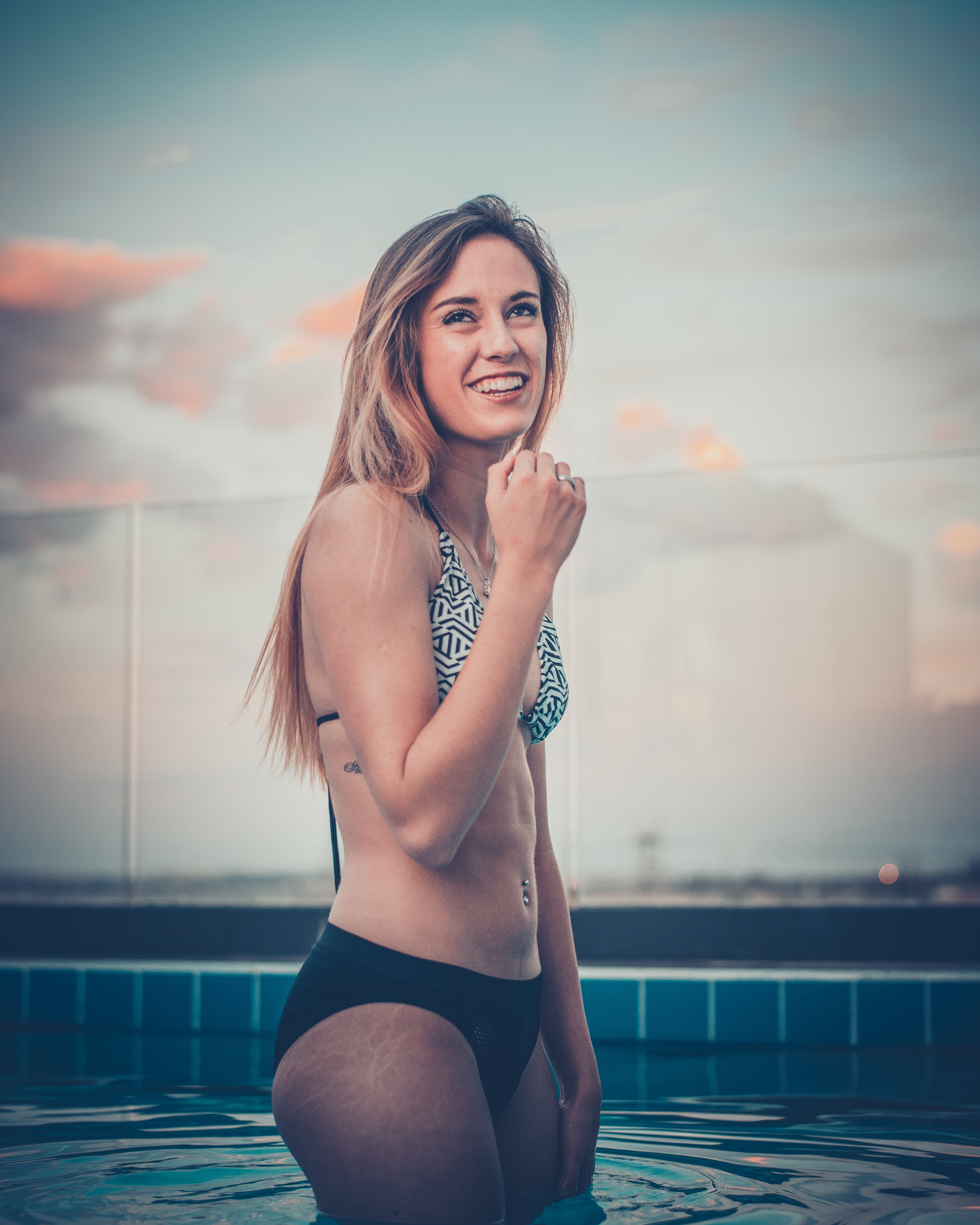 Smiling Woman Standing on Pool