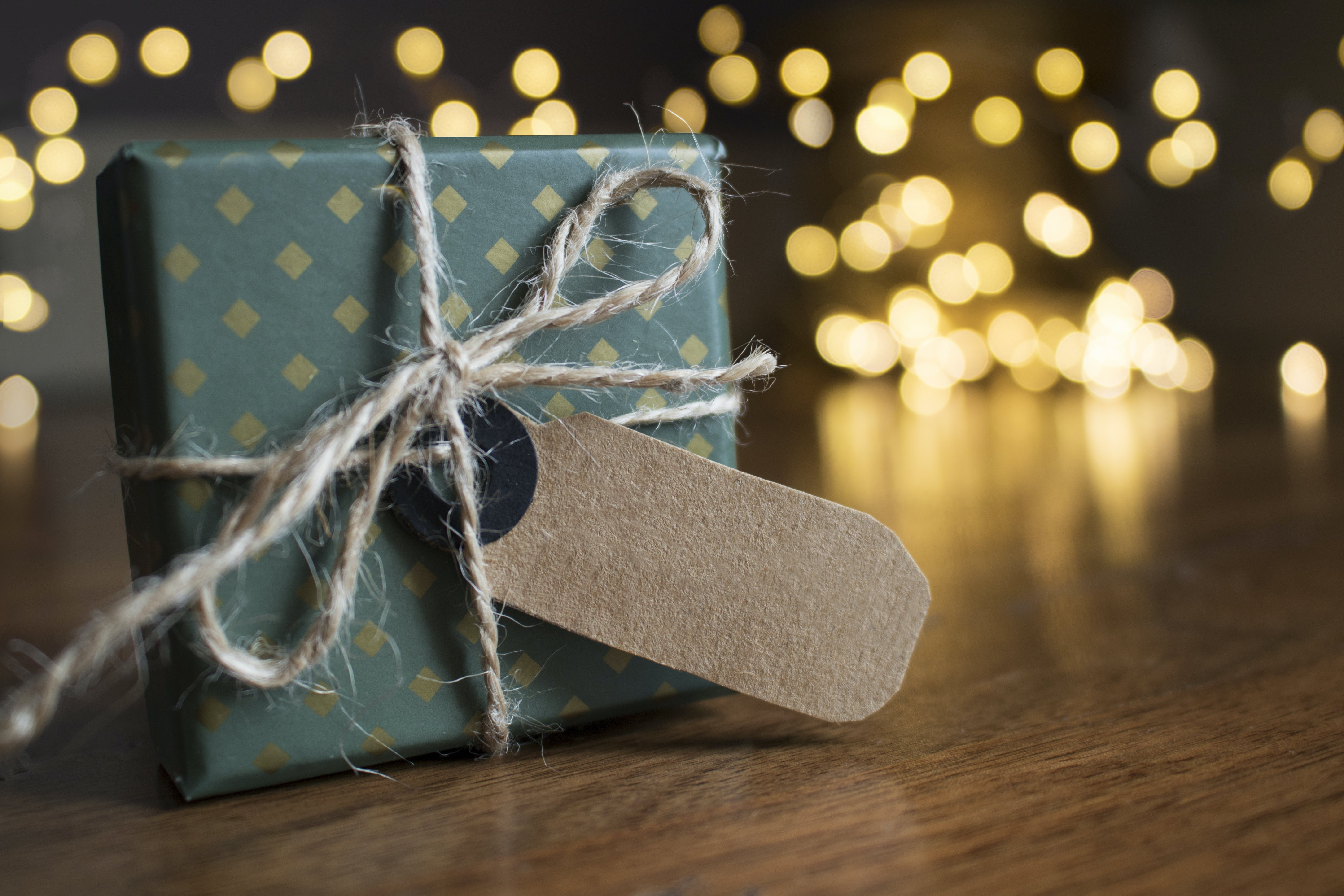 Selective Focus Photography Of Gift Box On Brown Wooden Surface