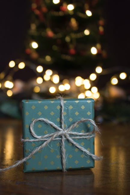 Close up photo of green gift box on brown wooden surface