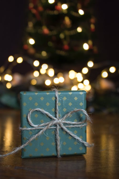 Close-up Photo of Green Gift Box on Brown Wooden Surface