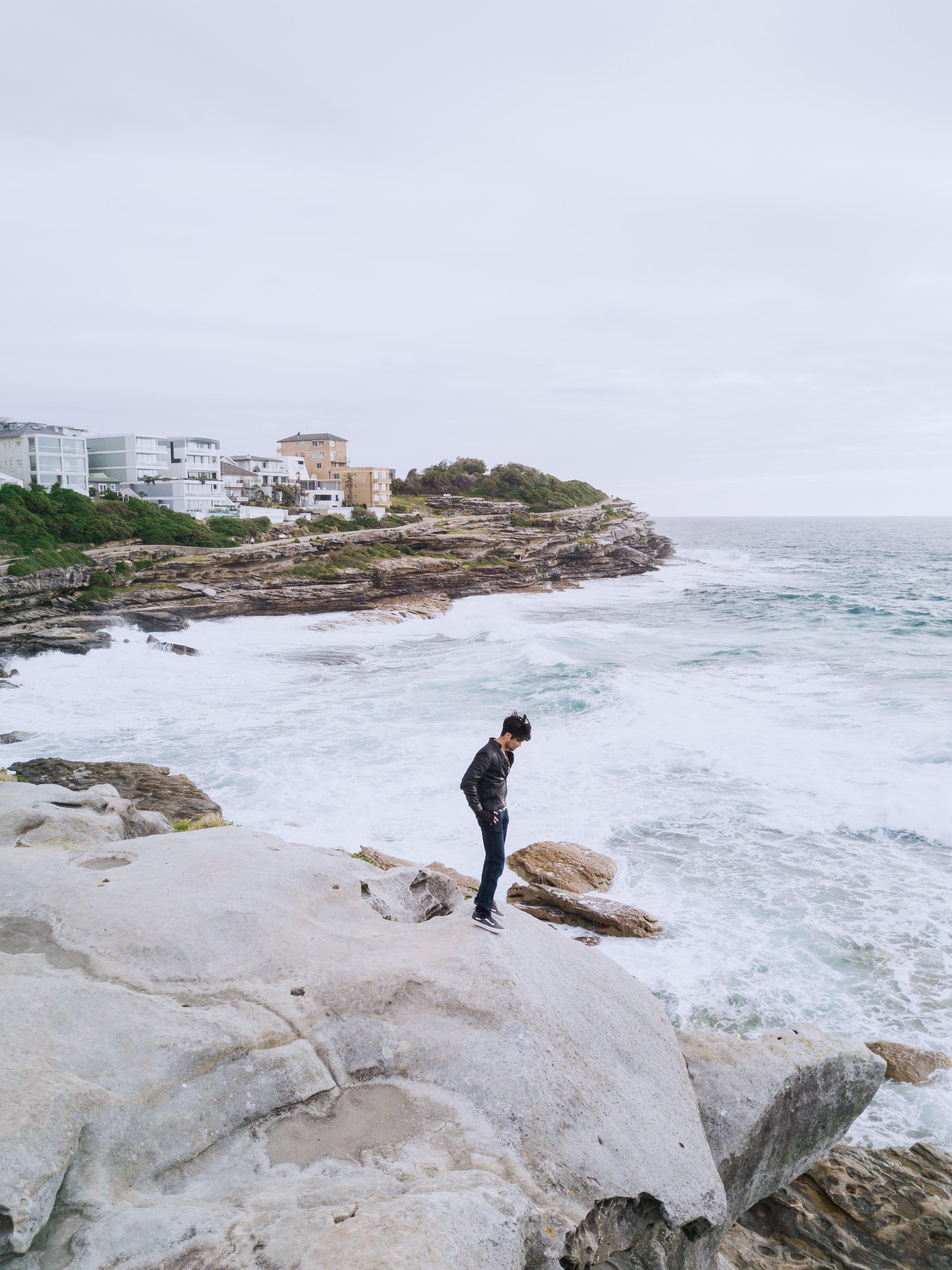 Man Standing Near Ocean