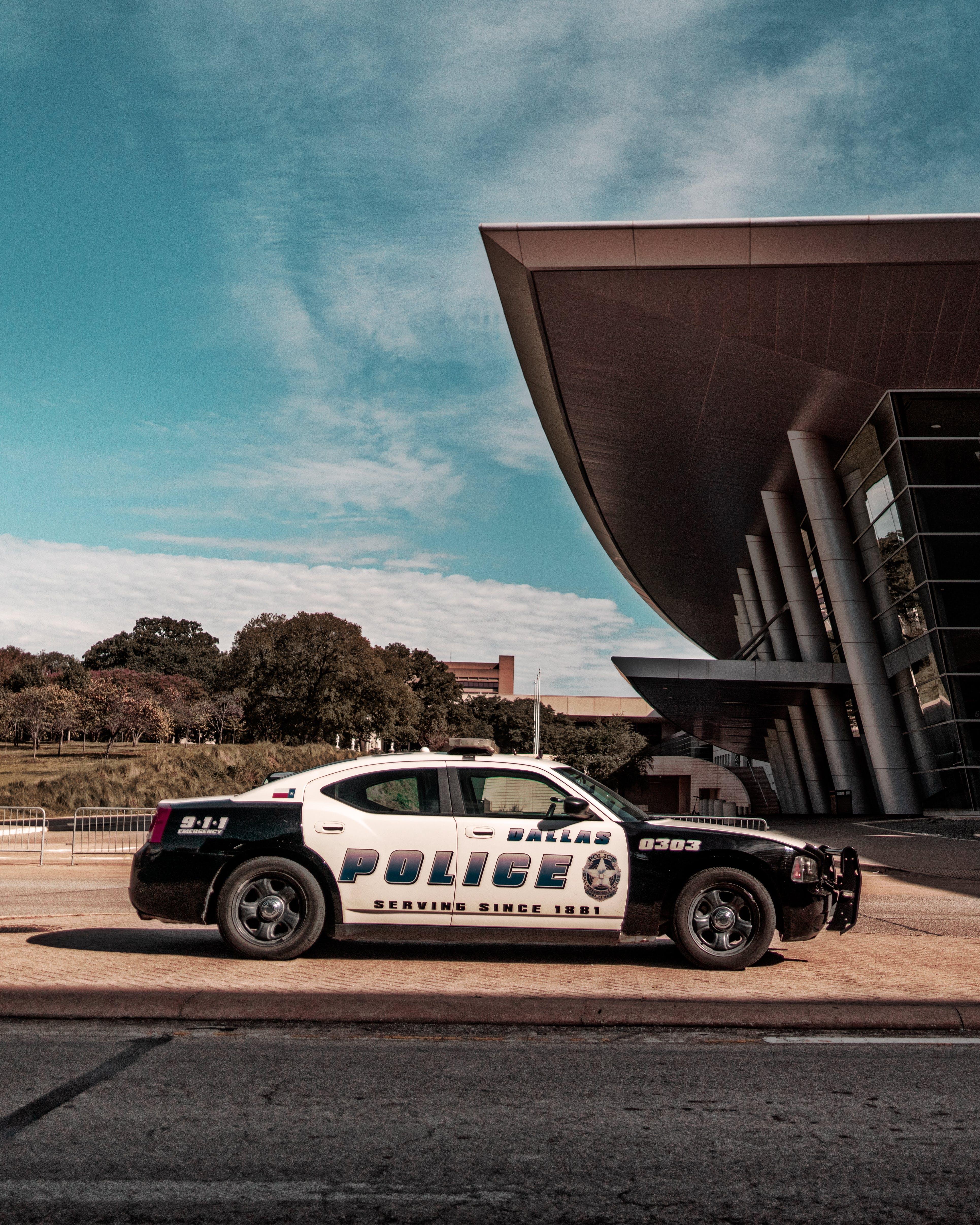 Police Car Parked Near Building