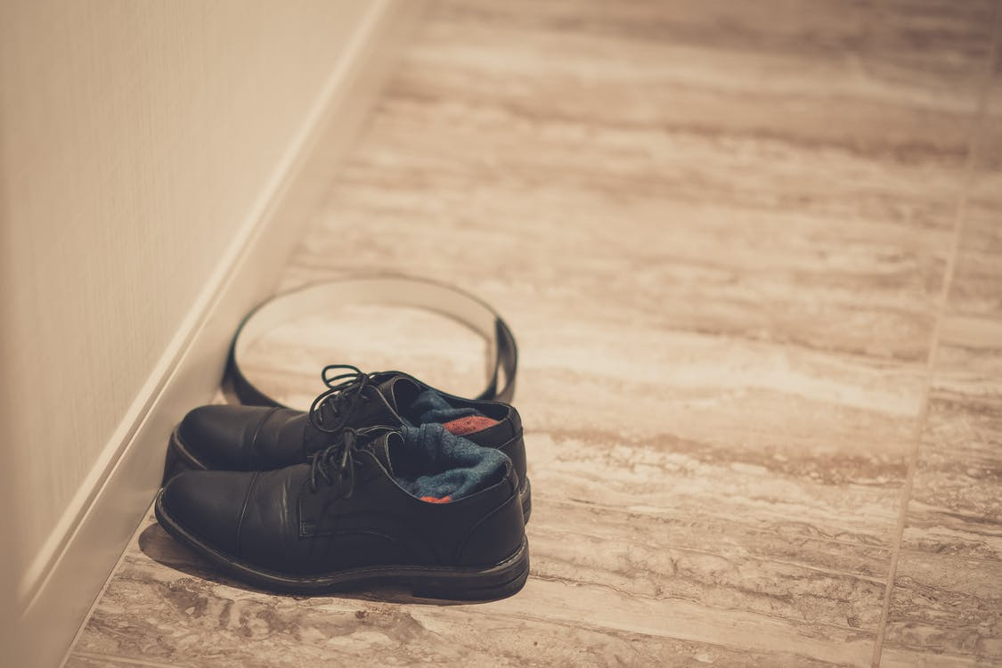 Black Leather Shoes on Floor