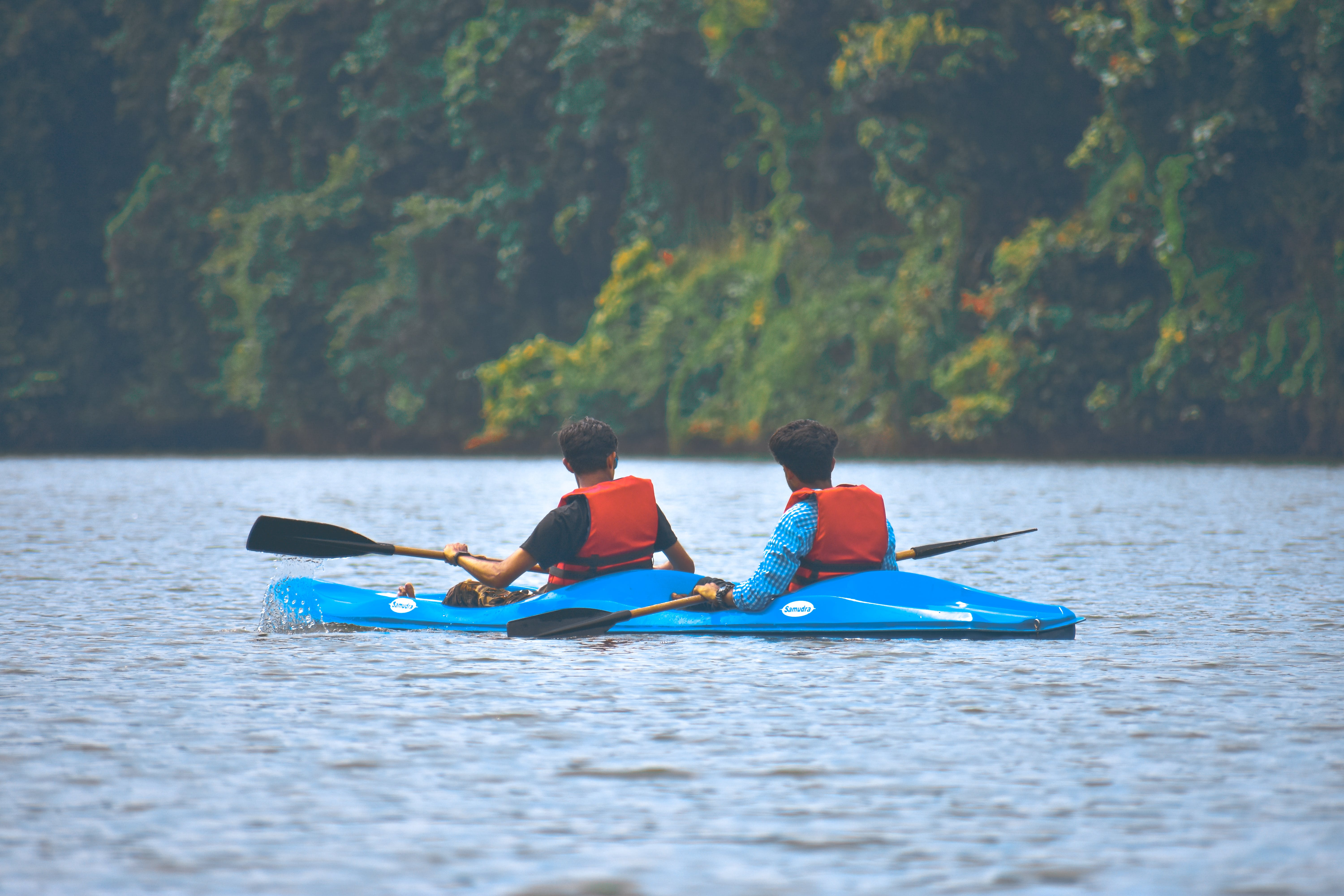 Two Men In Kayak