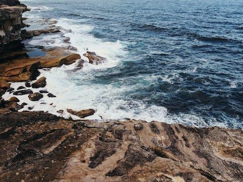 Photos gratuites de bord de mer, cailloux, faire signe, mer