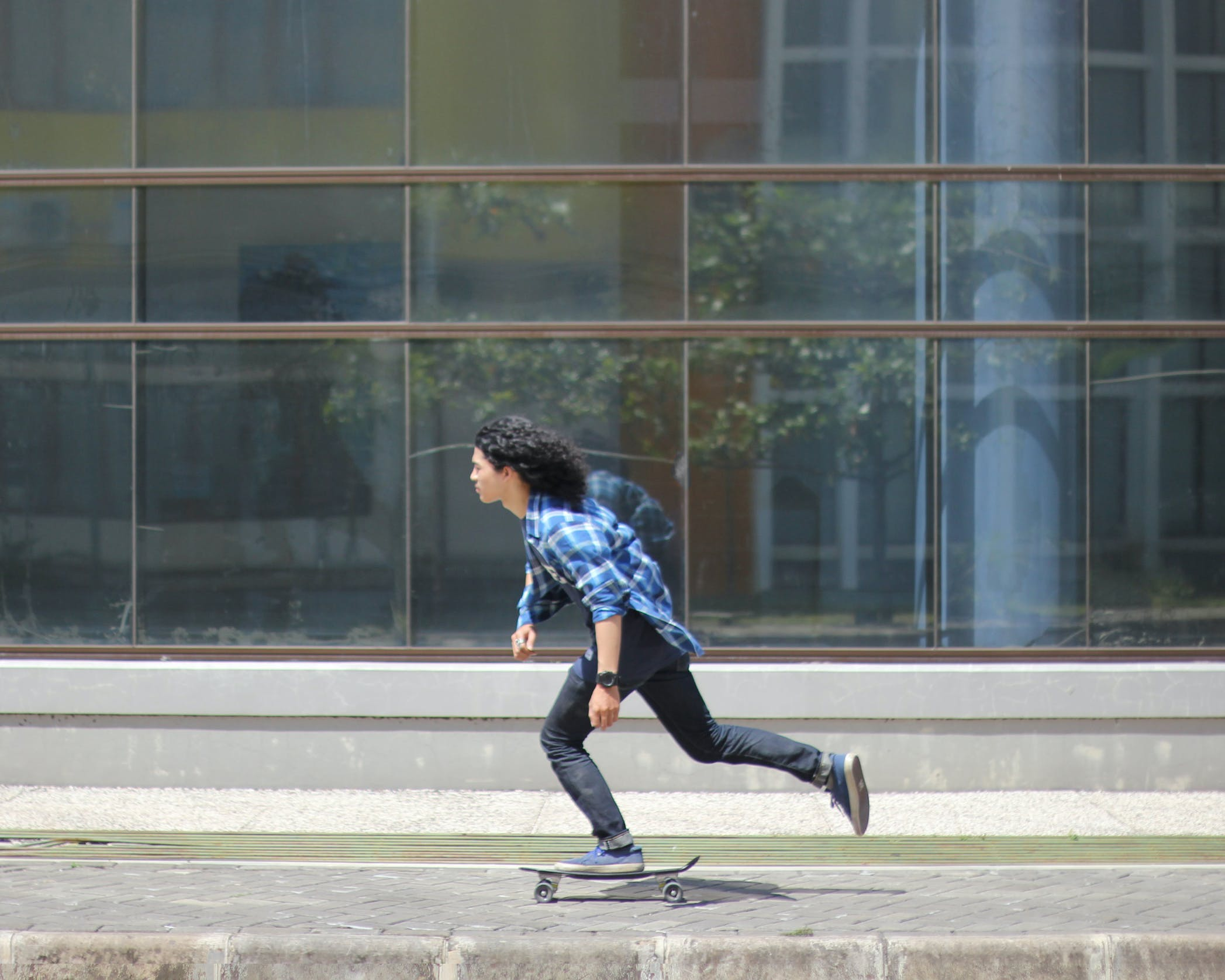 Man in Sport Shirt Riding Skateboard