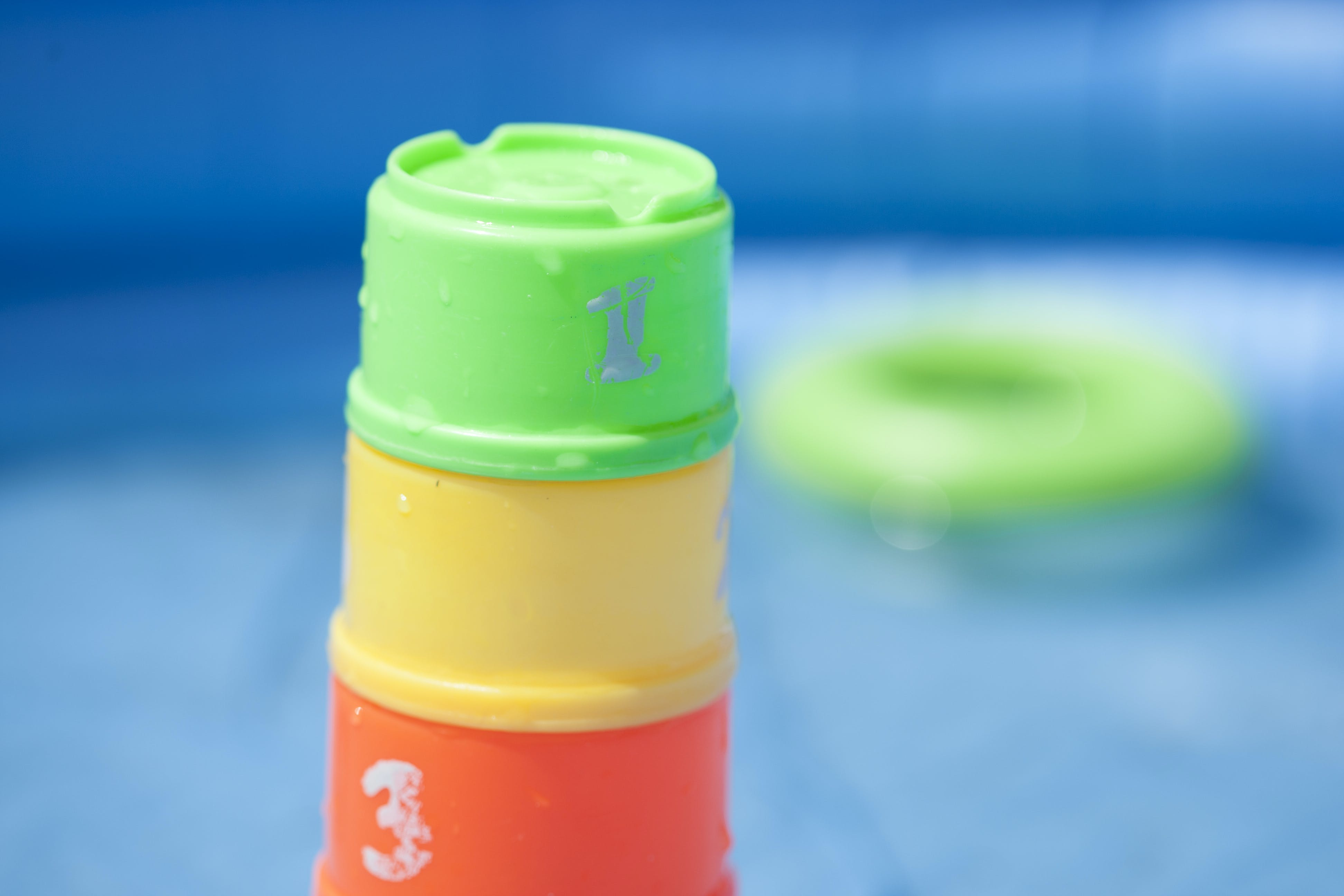 Free stock photo of pool, pool safety, stacking cups, swimming