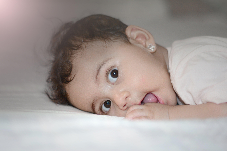 Baby Wearing White Top