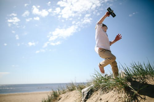 Man Leaping on Seashore