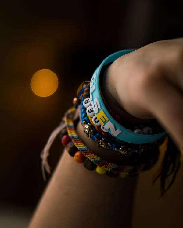 Close-Up Photo of Person Wearing Assorted Bracelets